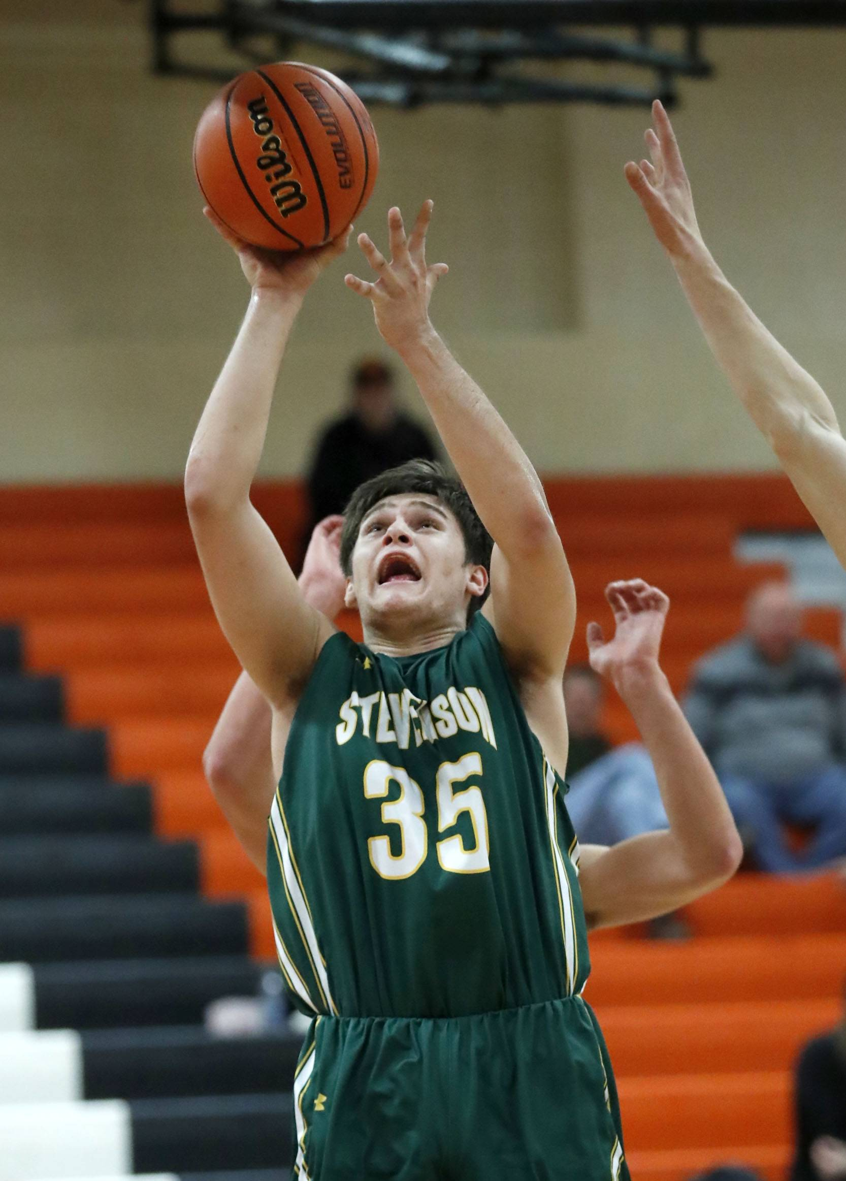 Stevenson's Matthew Kaznikov shoots during their game Tuesday night in Libertyville.