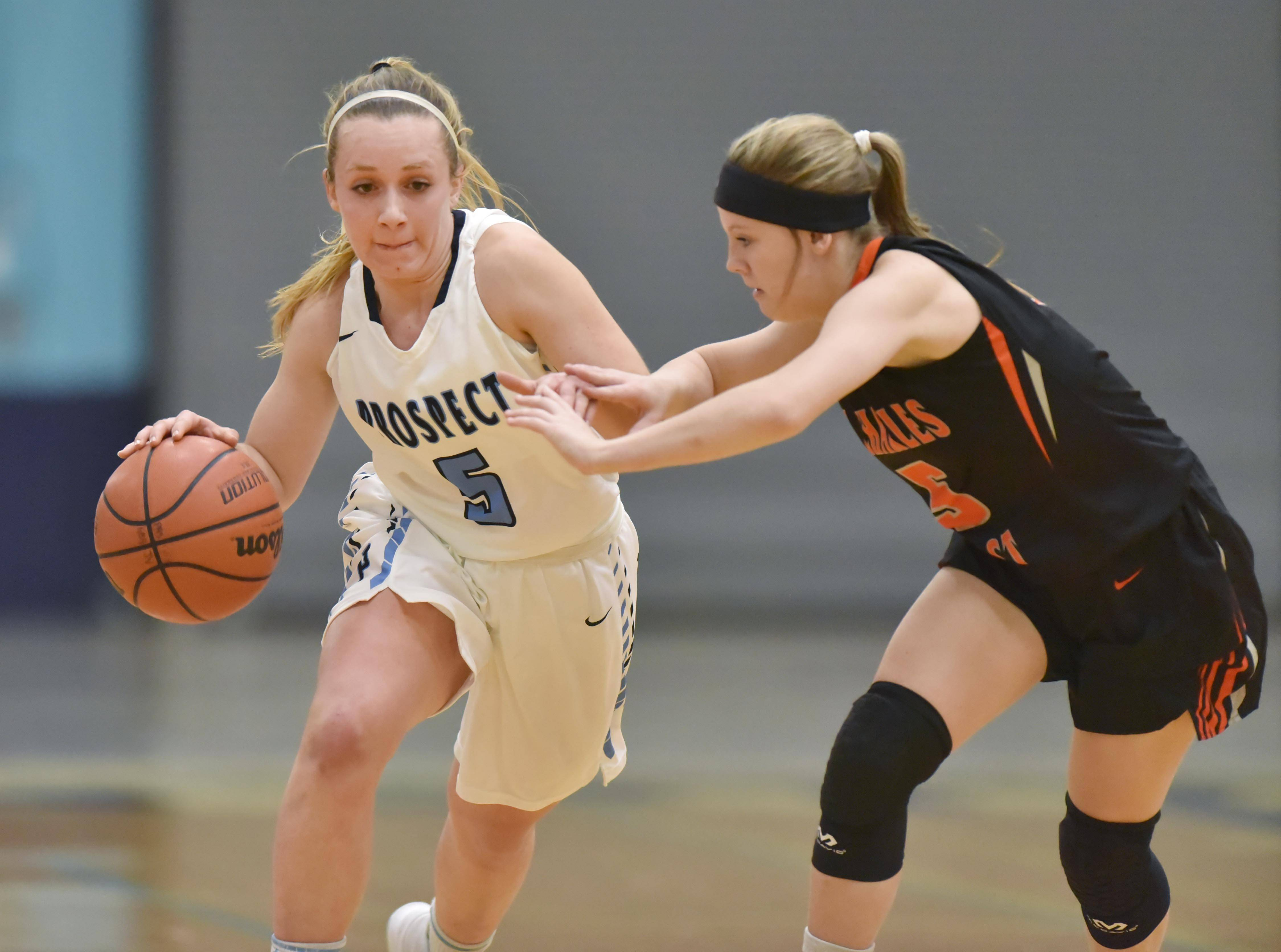 Prospect's Helen Siavelis dribbles up court against St. Charles East's Leah Griffin Wednesday in a girls basketball game in Mount Prospect.