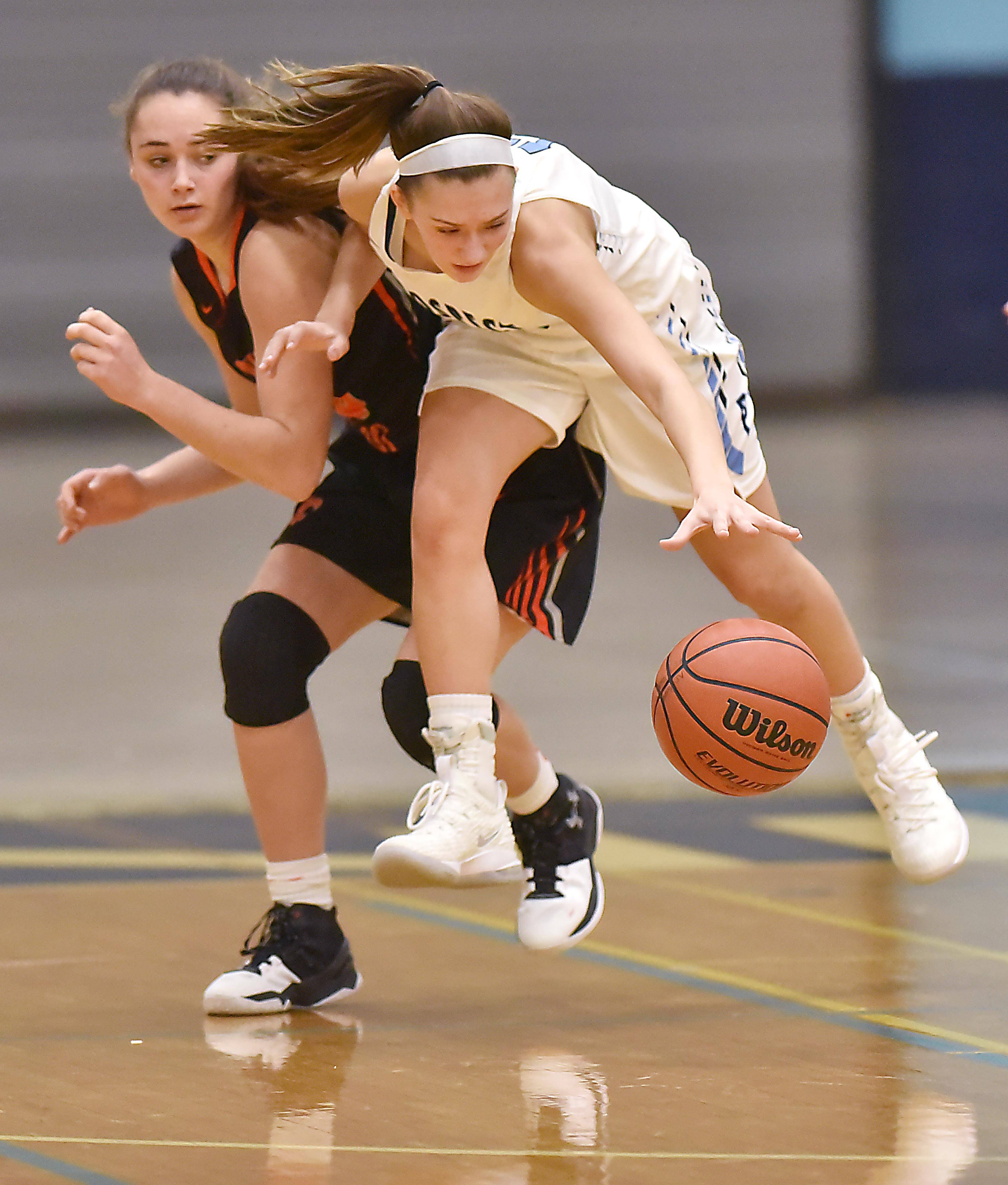 Prospect's Jessica Kowalczyk gets position on St. Charles East's Makenna Brown Wednesday in a girls basketball game in Mount Prospect.