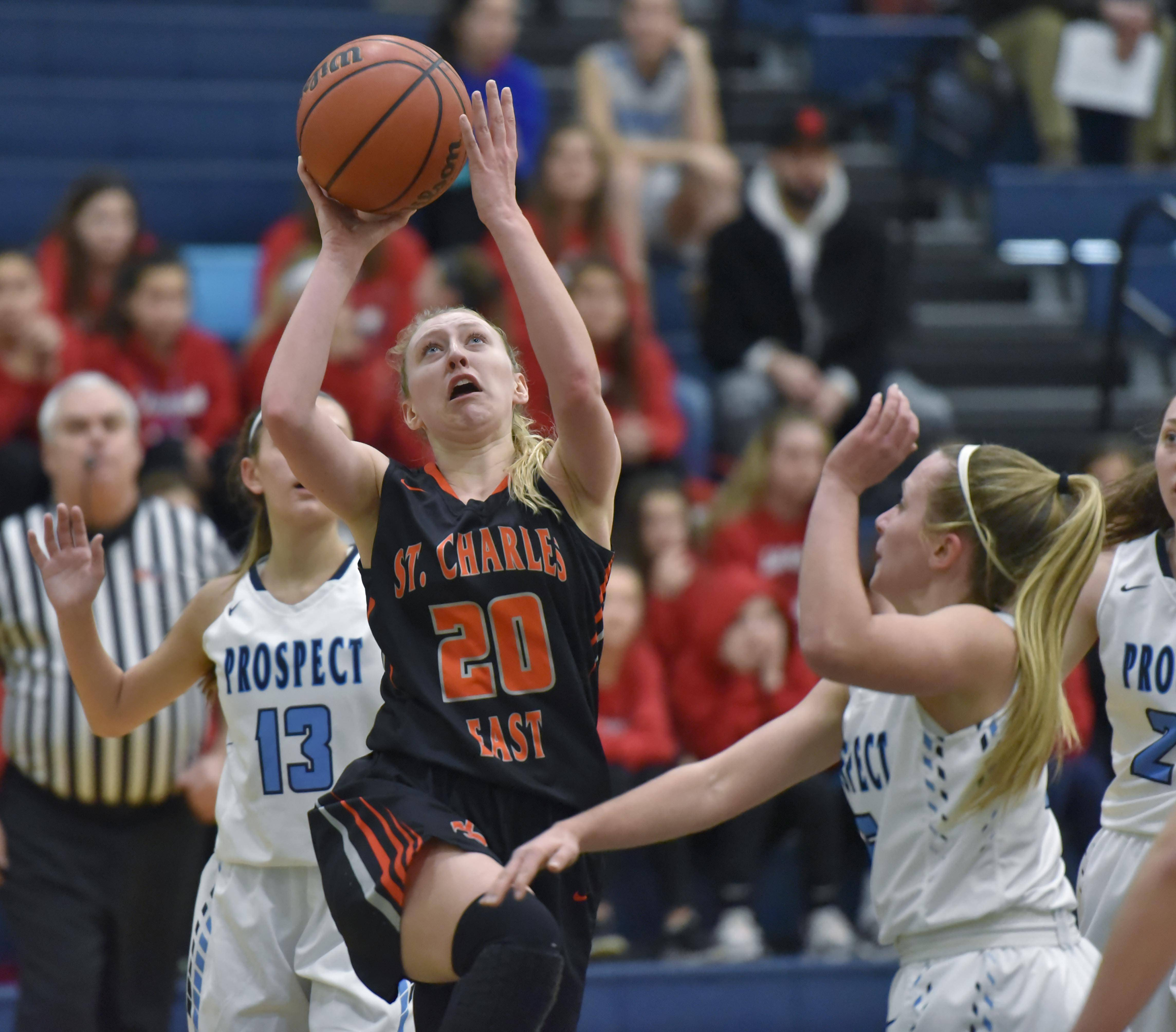 St. Charles East's Alexis Kiefer puts up a shot against Prospect's Helen Siavelis Wednesday in a girls basketball game in Mount Prospect.