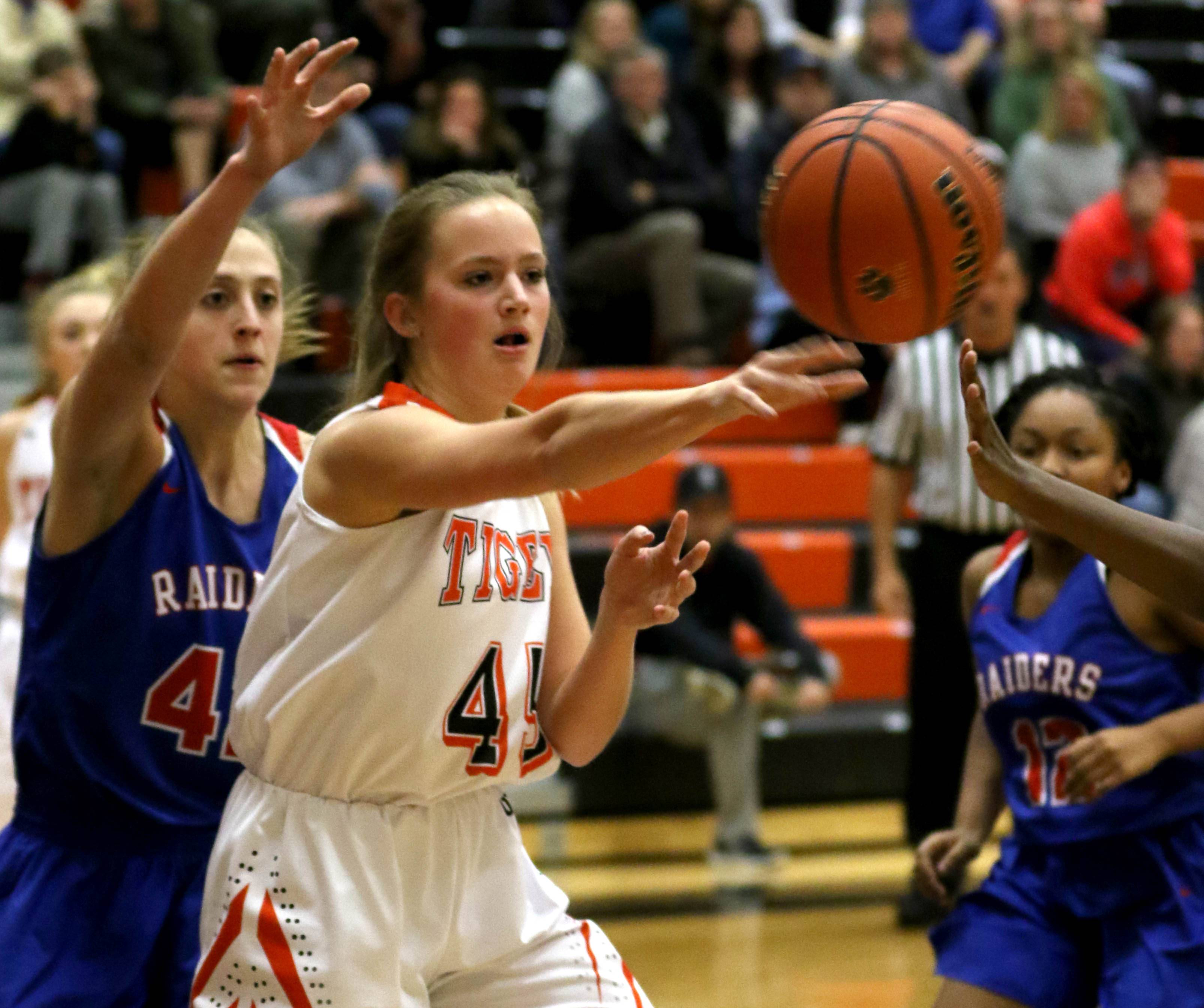 Wheaton Warrenville South's Katie Kroehnke dishes the ball against Glenbard South during varsity girls basketball at Wheaton Warrenville South High School Wednesday evening.