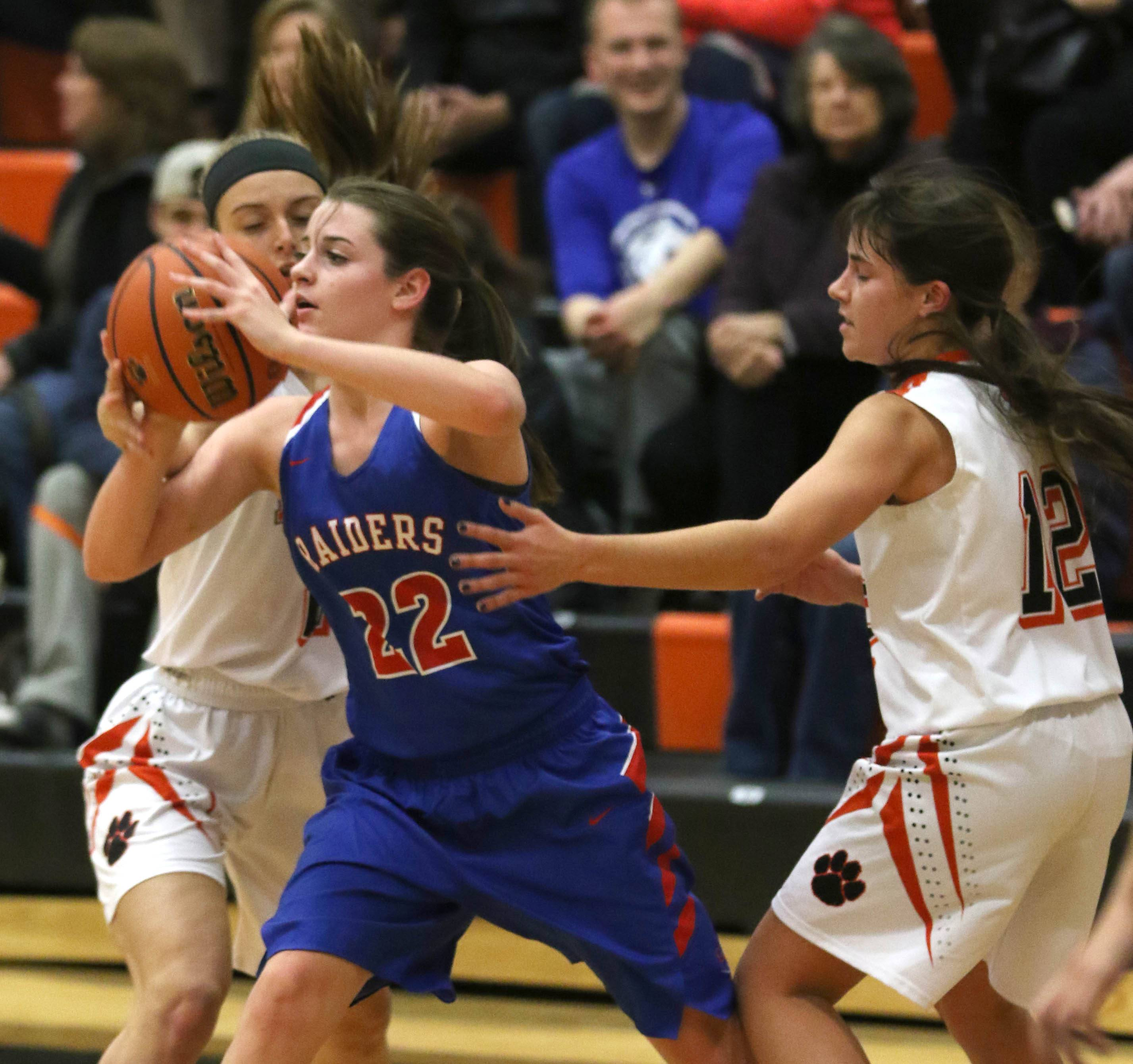 Glenbard South's Rocky LaPonte looks for an open teammate during varsity girls basketball at Wheaton Warrenville South High School Wednesday evening.