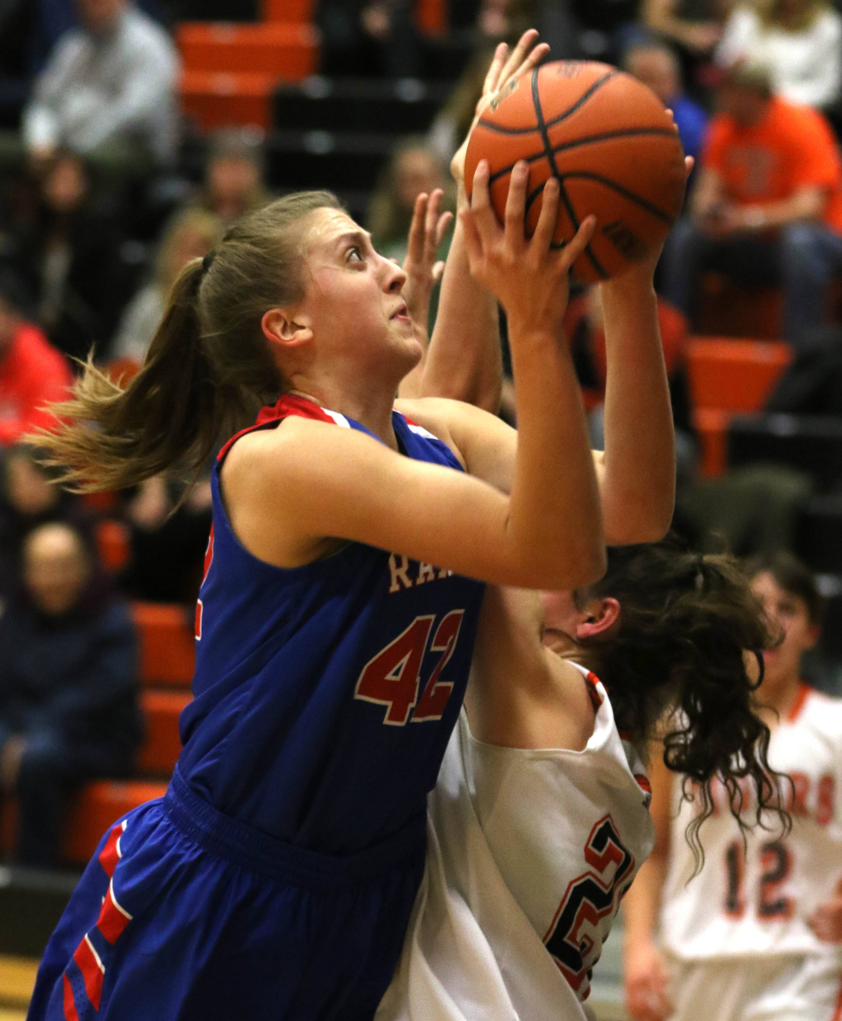 Glenbard South's Maggie Bair moves to the hoop during varsity girls basketball at Wheaton Warrenville South High School Wednesday evening.