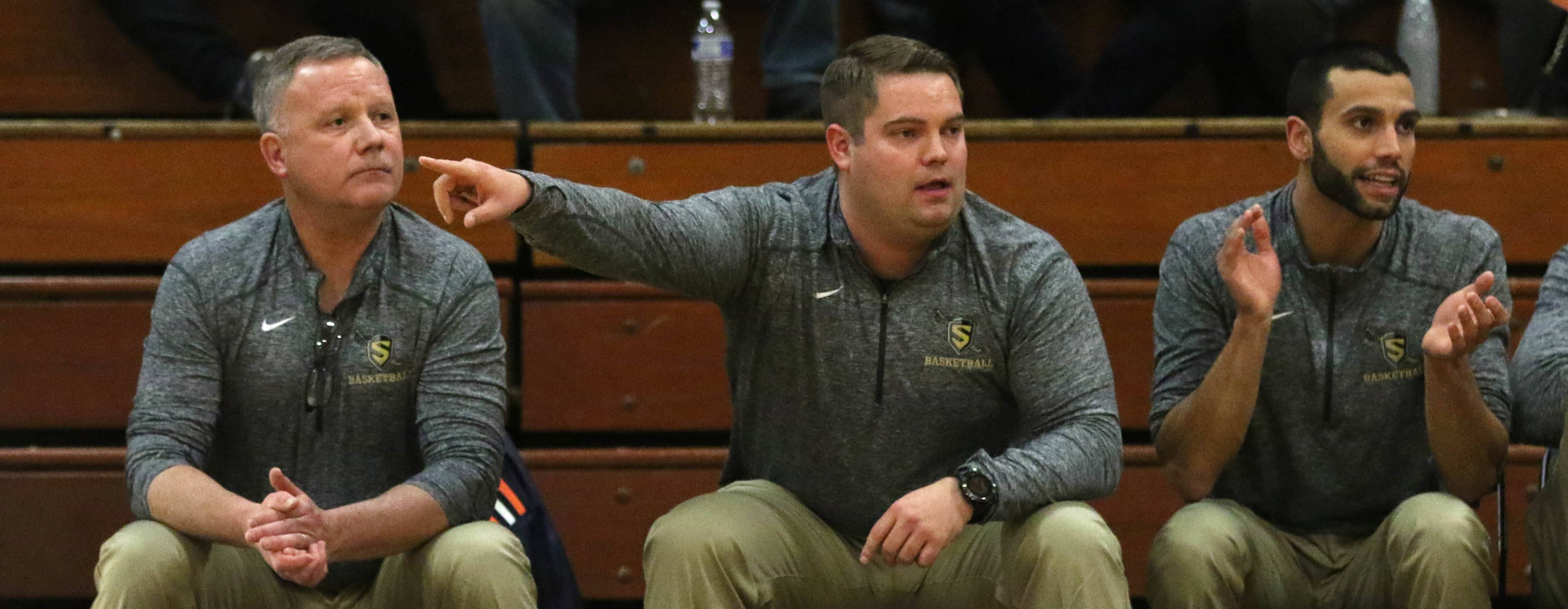 Streamwood coaches Kent Payne and his son Cully along with assistant Nick Neari monitor the action against St. Charles East during varsity boys basketball at St. Charles on Tuesday night.