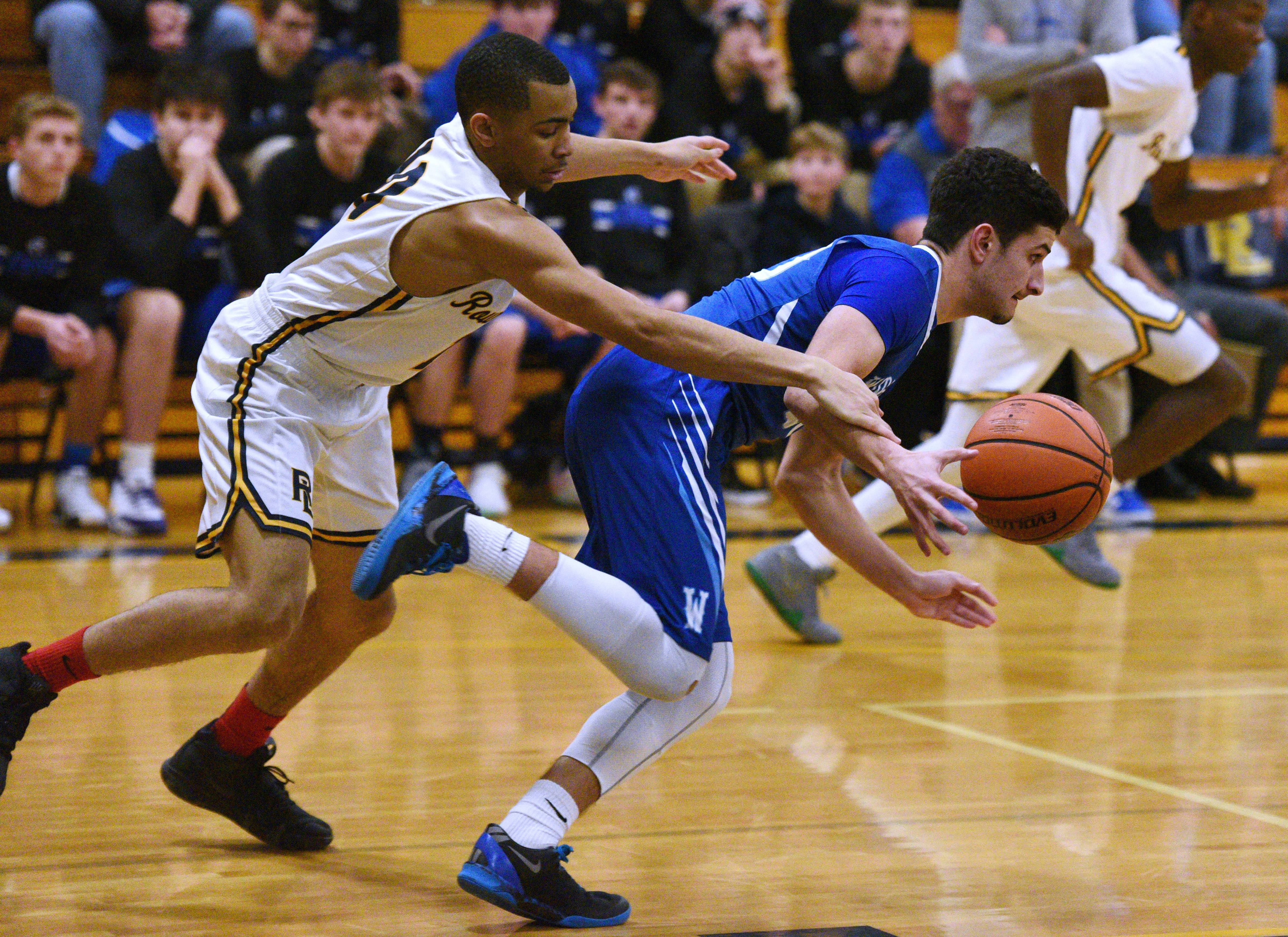 Round Lake's Isaiah Nixon, left, pressures Woodstock's David Shinherr during Thursday's boys basketball game in Round Lake.