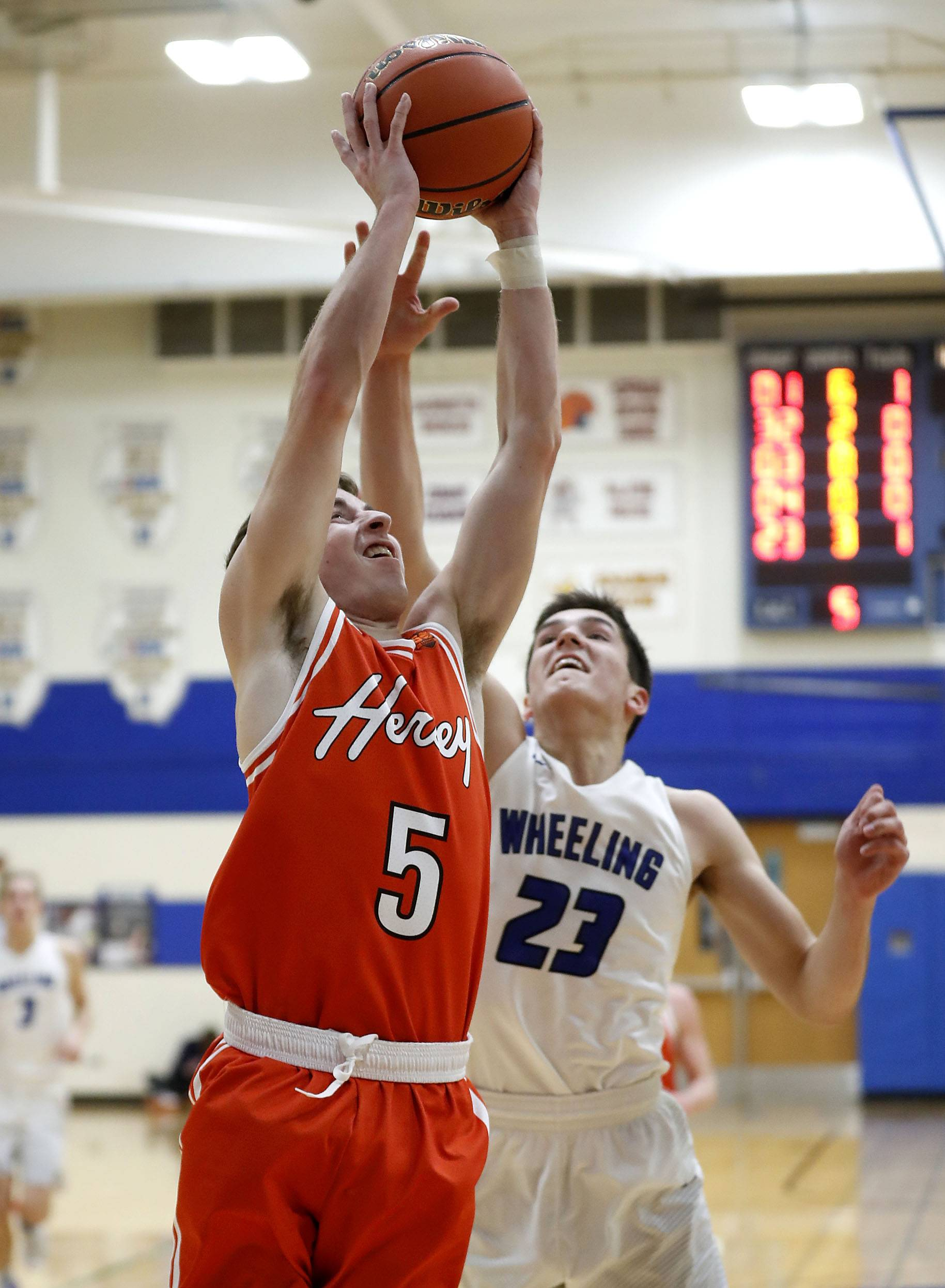 Hersey's Davis Belford (5) drives on Wheeling's Michael Best during their game Friday at Wheeling High School.