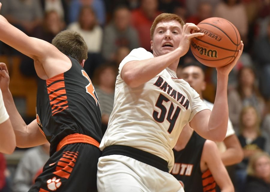Batavia's Devin Cheaney gets a rebound against Wheaton Warrenville South in a boys basketball game in Batavia Friday.