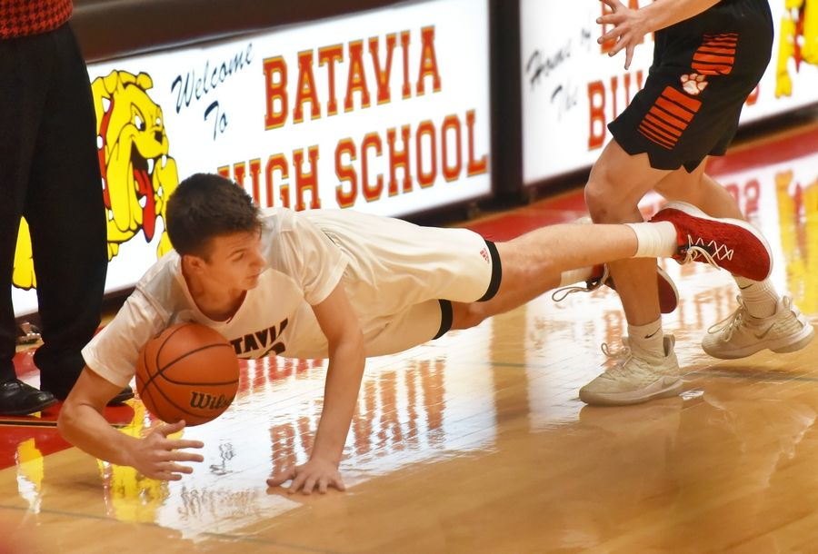 Batavia's Marko Yager falls against Wheaton Warrenville South in a boys basketball game in Batavia Friday.