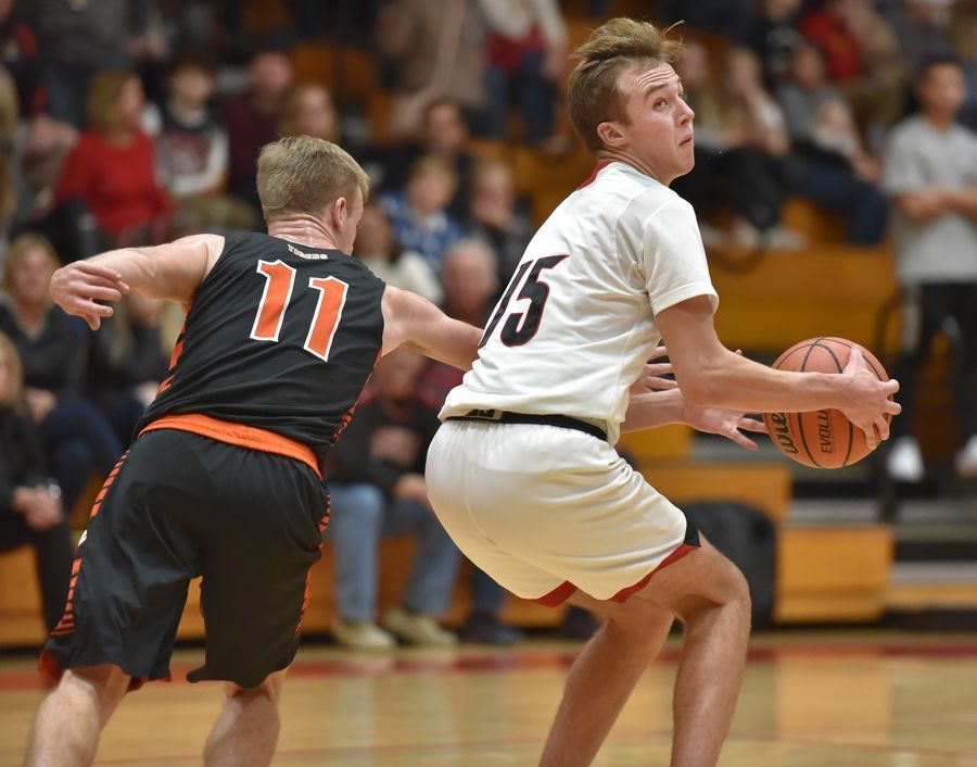 Batavia's Zack Weber spins away from Wheaton Warrenville South's Joe Ives in Batavia Friday.