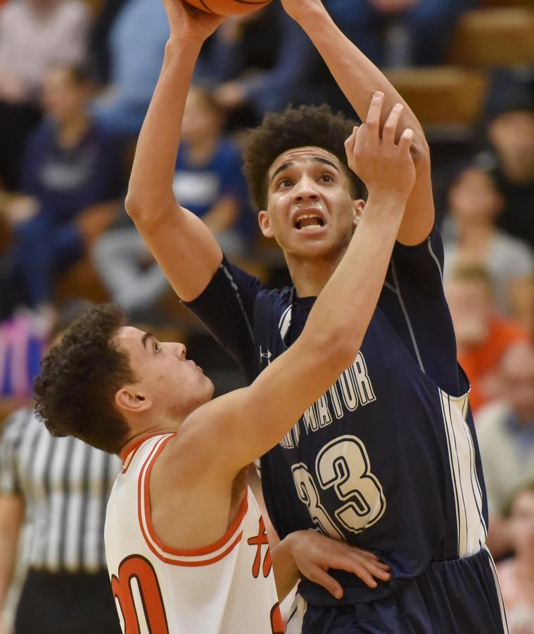St. Viator's Jeremiah Hernandez shoots over Hersey's Clay Augustyn Saturday in a boys basketball game in Arlington Heights.