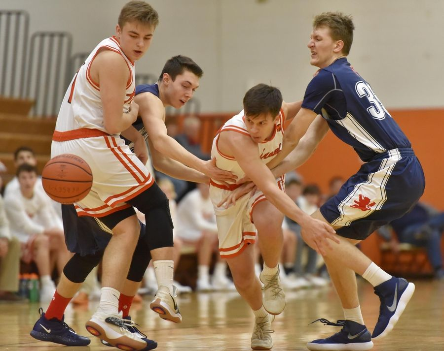 Hersey's Rocco Ronzio chases the ball knocked away by St. Viator's Michael Huene, right, as Viator's Connor Kuchera and Hersey's Jacob Kluczewski watch the play develop Saturday in a boys basketball game in Arlington Heights.