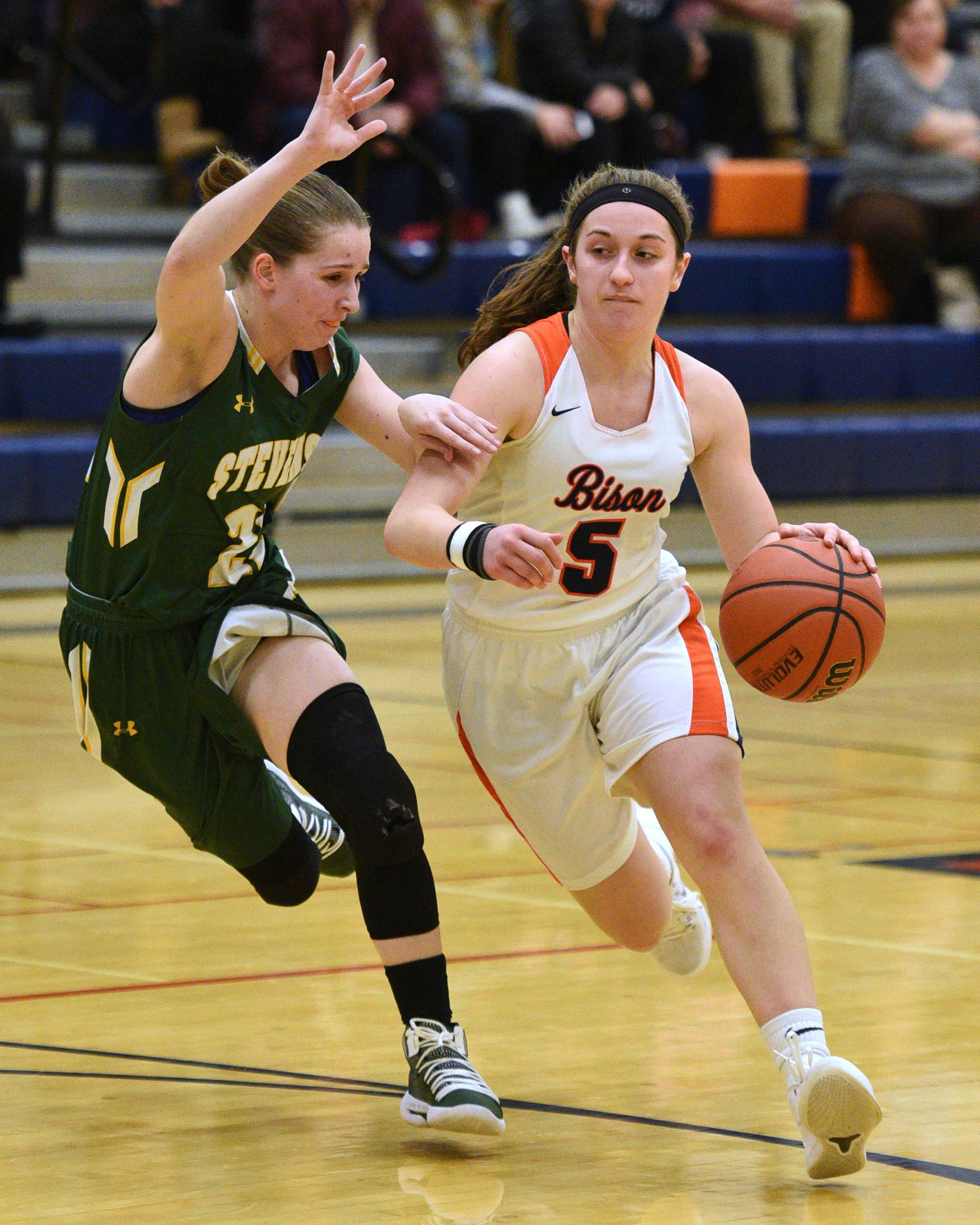 Stevenson's Lydia Lueck, left, pressures Buffalo Grove's Jackie Bickhaus (5) during Monday's girls basketball game in Buffalo Grove.