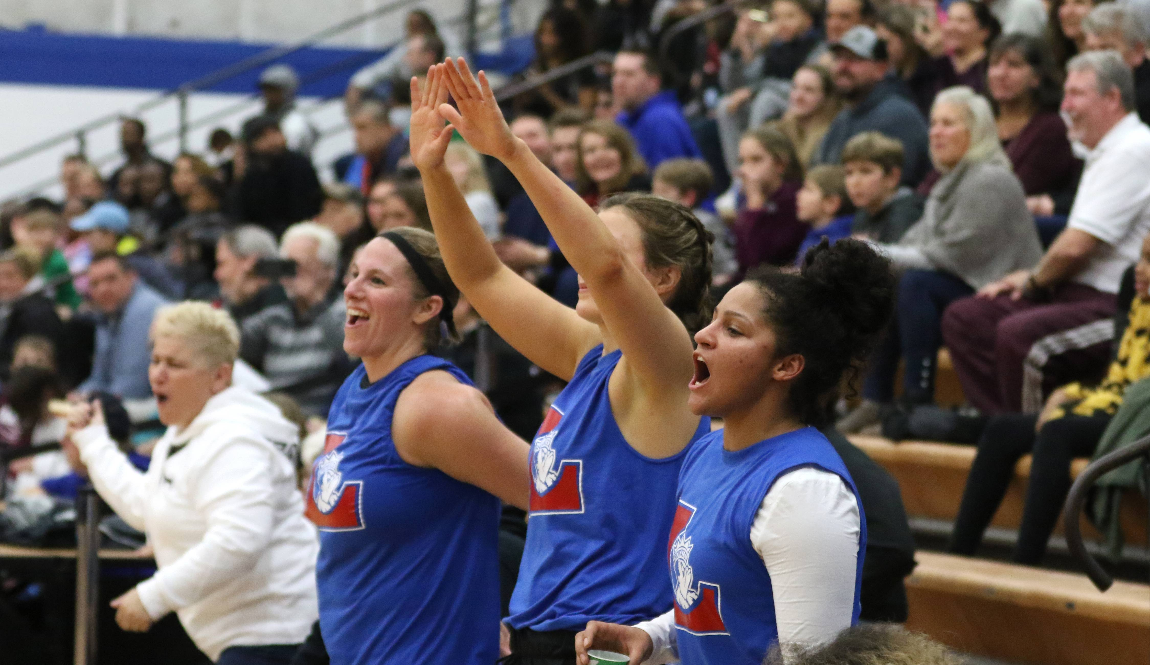 Larkin alumni and fans get revved up at the conclusion of the women's game as part of Larkin vs. Elgin Part 2 alumni games at Larkin High School in Elgin Wednesday night.