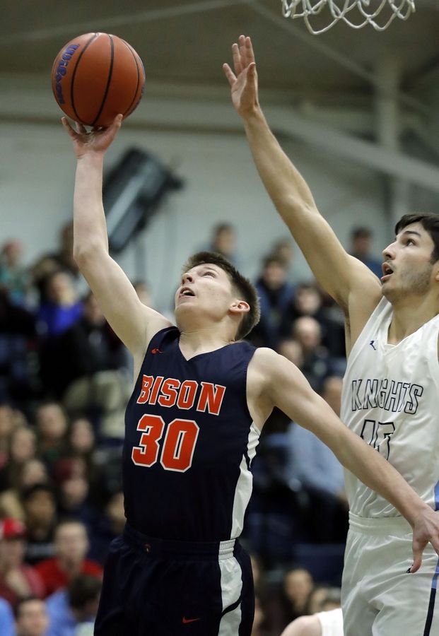 Buffalo Grove's Tyler Kipley (30) drives on Prospect's Sam Murray during their game Friday night at Prospect High School.