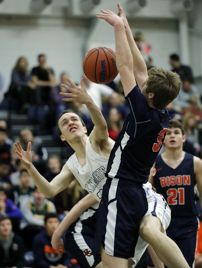 Prospect's Jonathan Kreidler, left, and Buffalo Grove's Nathan Cole battle for a rebound during their game Friday night at Prospect High School.