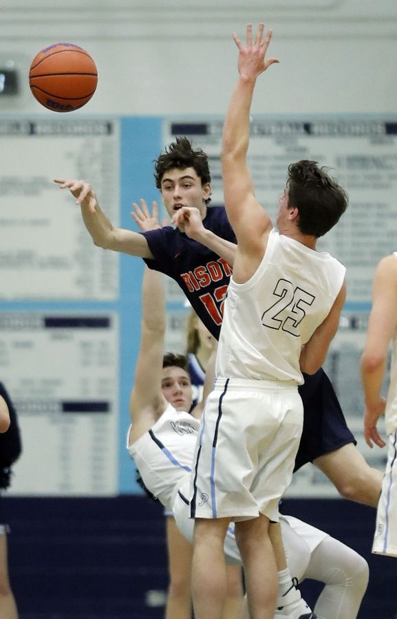 Buffalo Grove's Kamren Craft, left, dishes off around Prospect's Benjamin Zellmer during their game Friday night at Prospect High School.