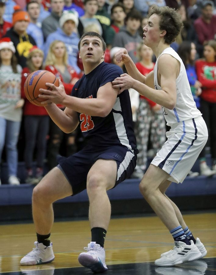 Buffalo Grove's Tom Trieb, left, drives on Prospect's Benjamin Miller during their game Friday night.