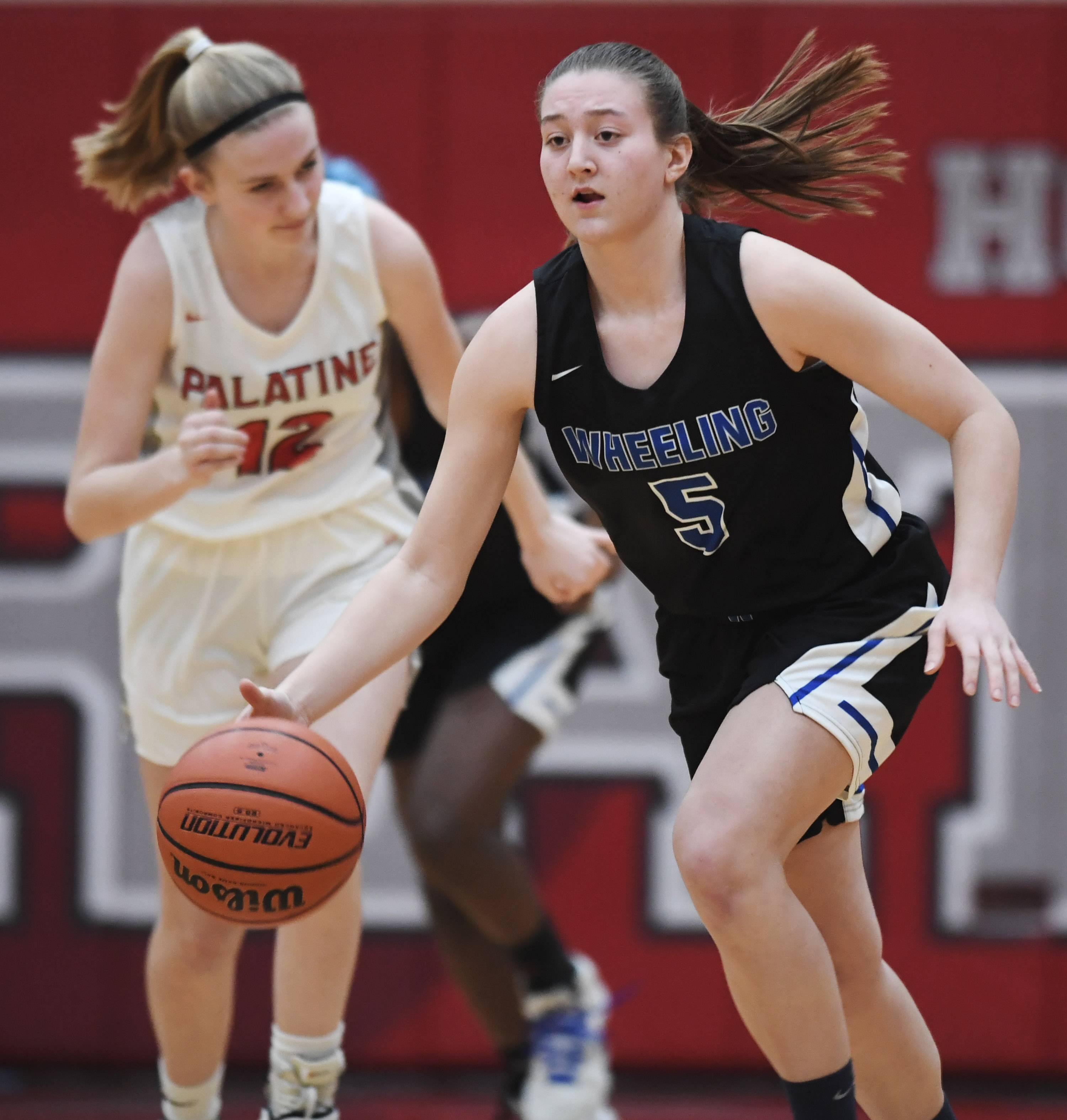 Wheeling's Sophia Stanke leads a fast break during Tuesday's game at Palatine.