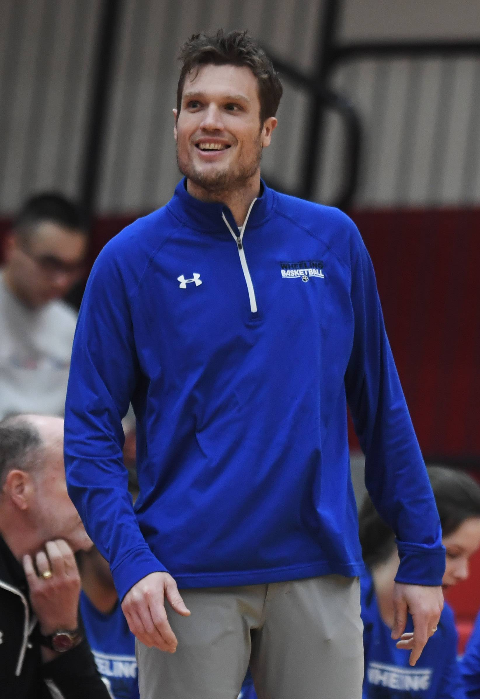 Wheeling girls basketball head coach Matt Weber leads his team during Tuesday's game at Palatine.