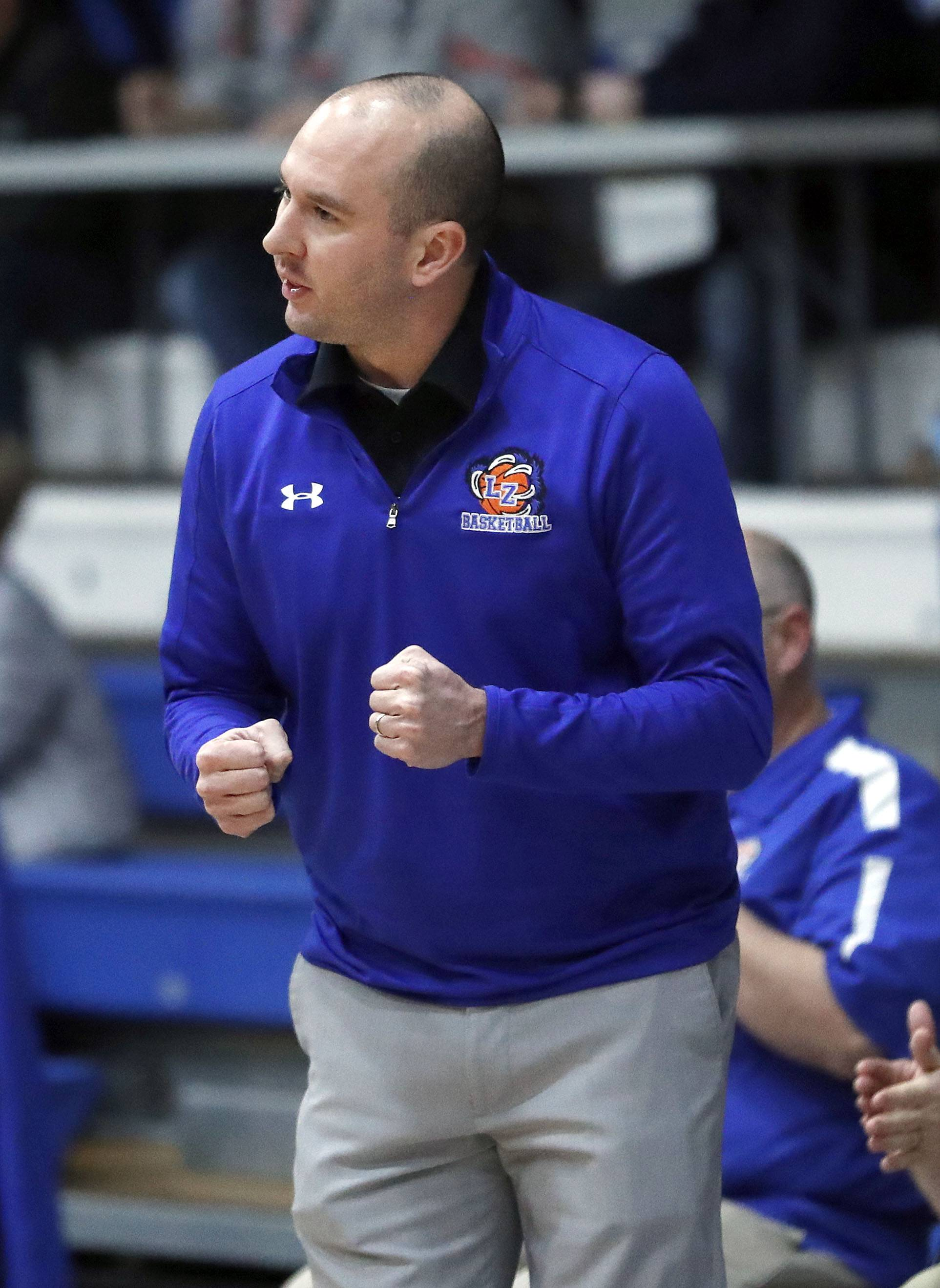 Lake Zurich head coach Terry Coughlin works the bench during their game against Mundelein Tuesday night in Lake Zurich.