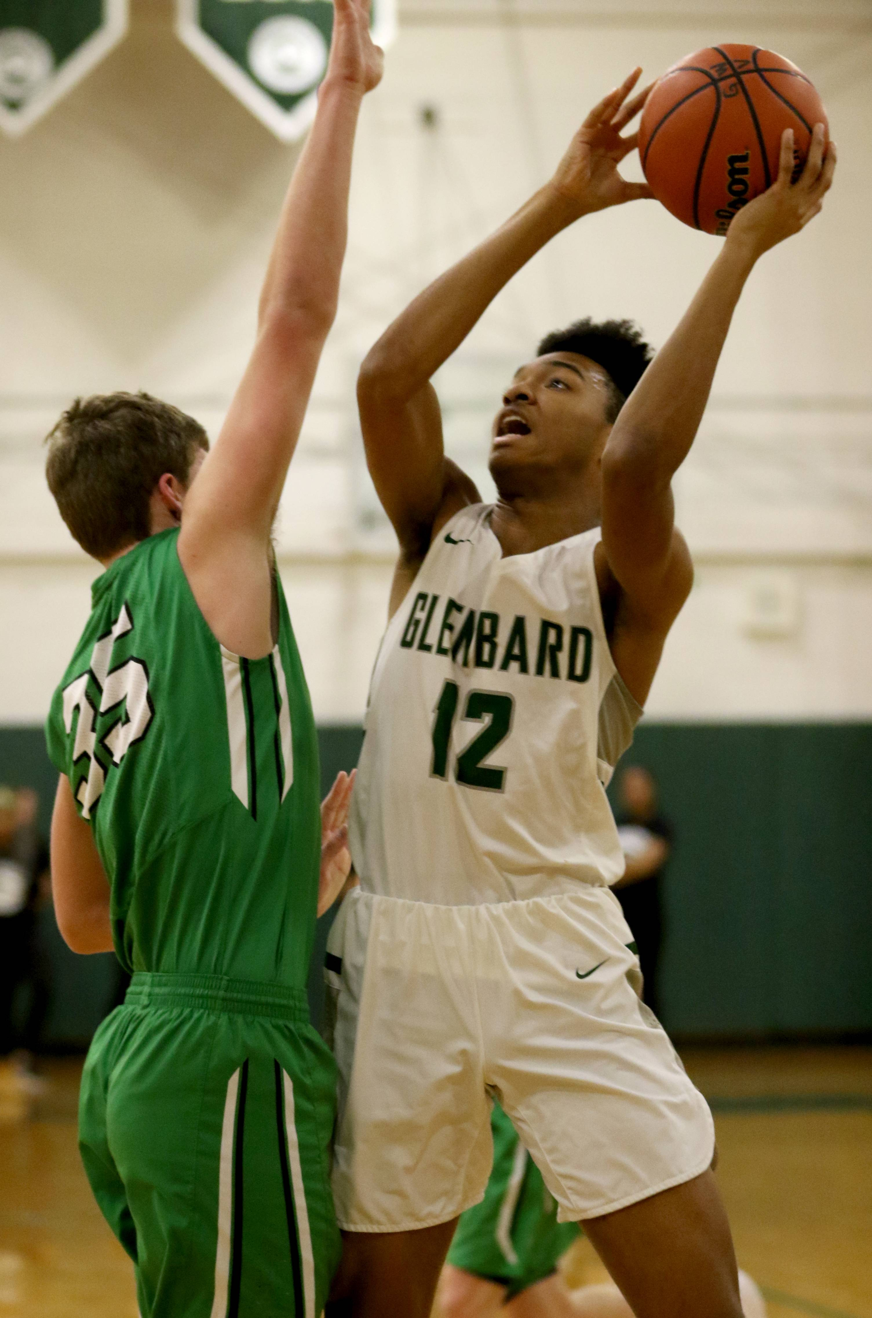 Glenbard West's Evan Taylor during varsity boys basketball against York at Fred L. Biester Gymnasium on the campus of Glenbard West Tuesday night.