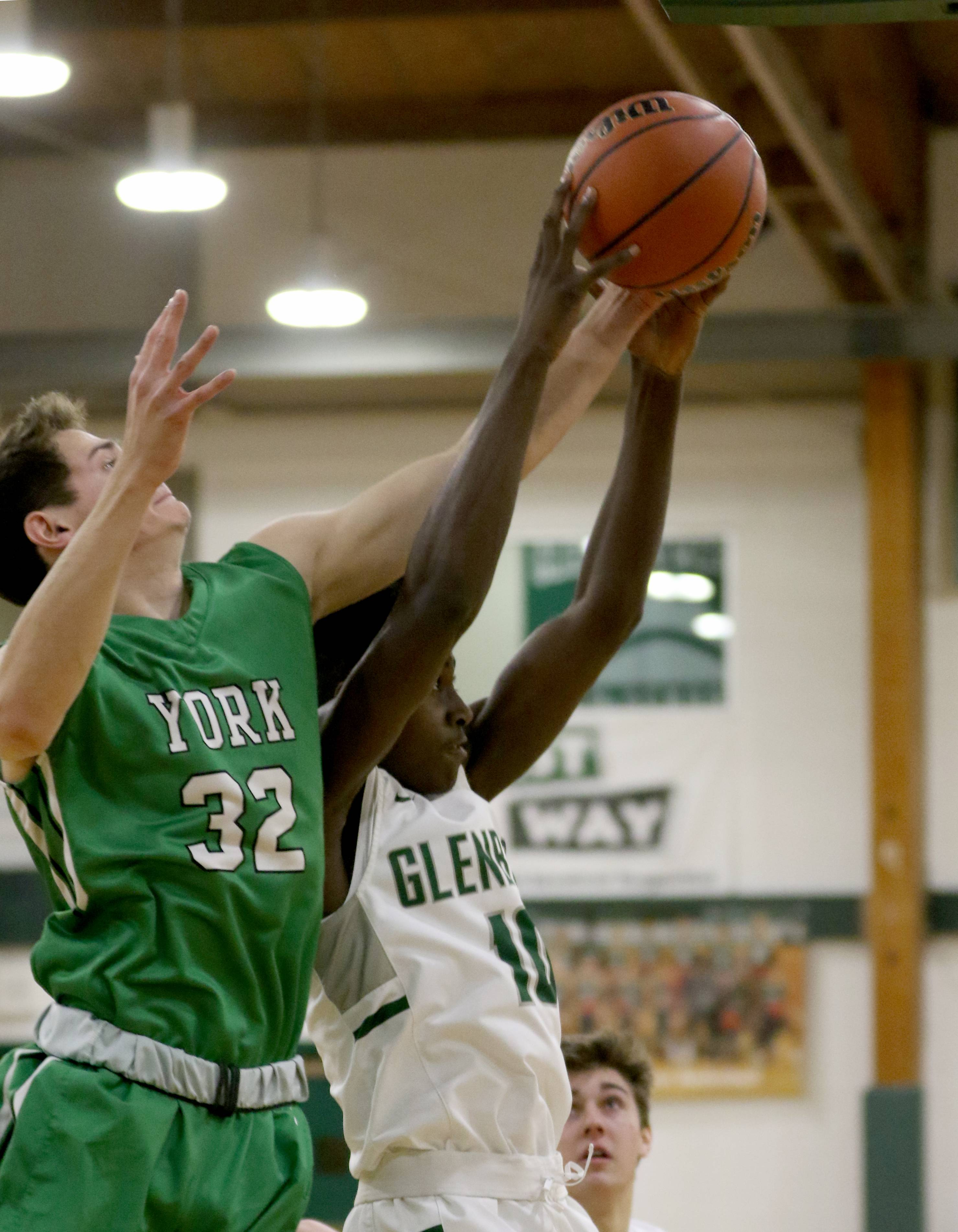 York's Erik Cohn, left, and Glenbard West's Griffin Foster battle during varsity boys basketball at Fred L. Biester Gymnasium on the campus of Glenbard West Tuesday night.