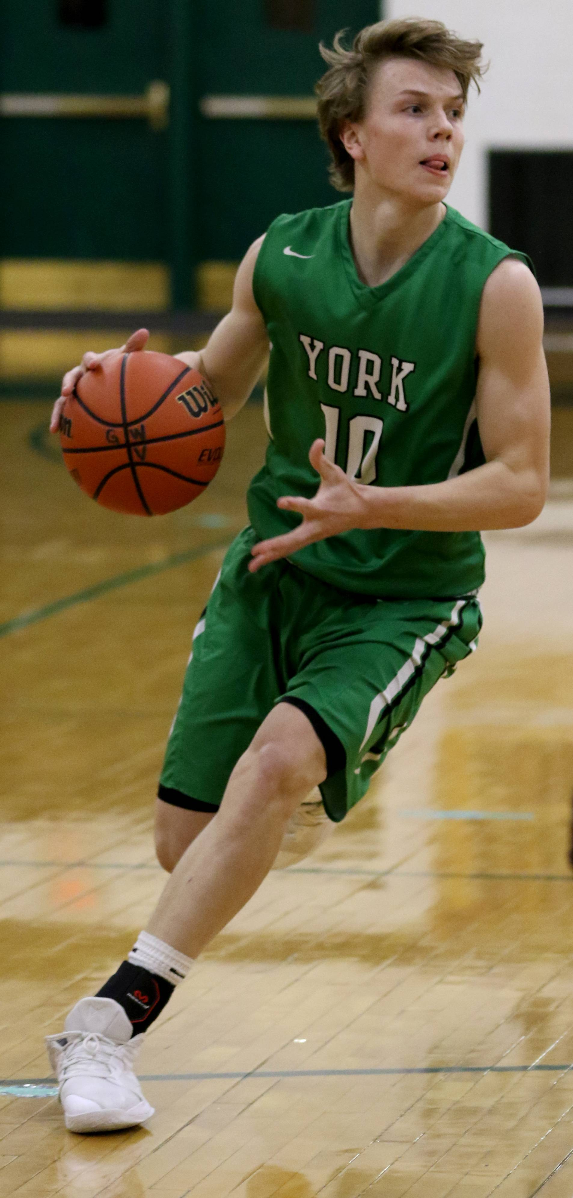 York's Nathan Shockey during varsity boys basketball at Fred L. Biester Gymnasium on the campus of Glenbard West Tuesday night.