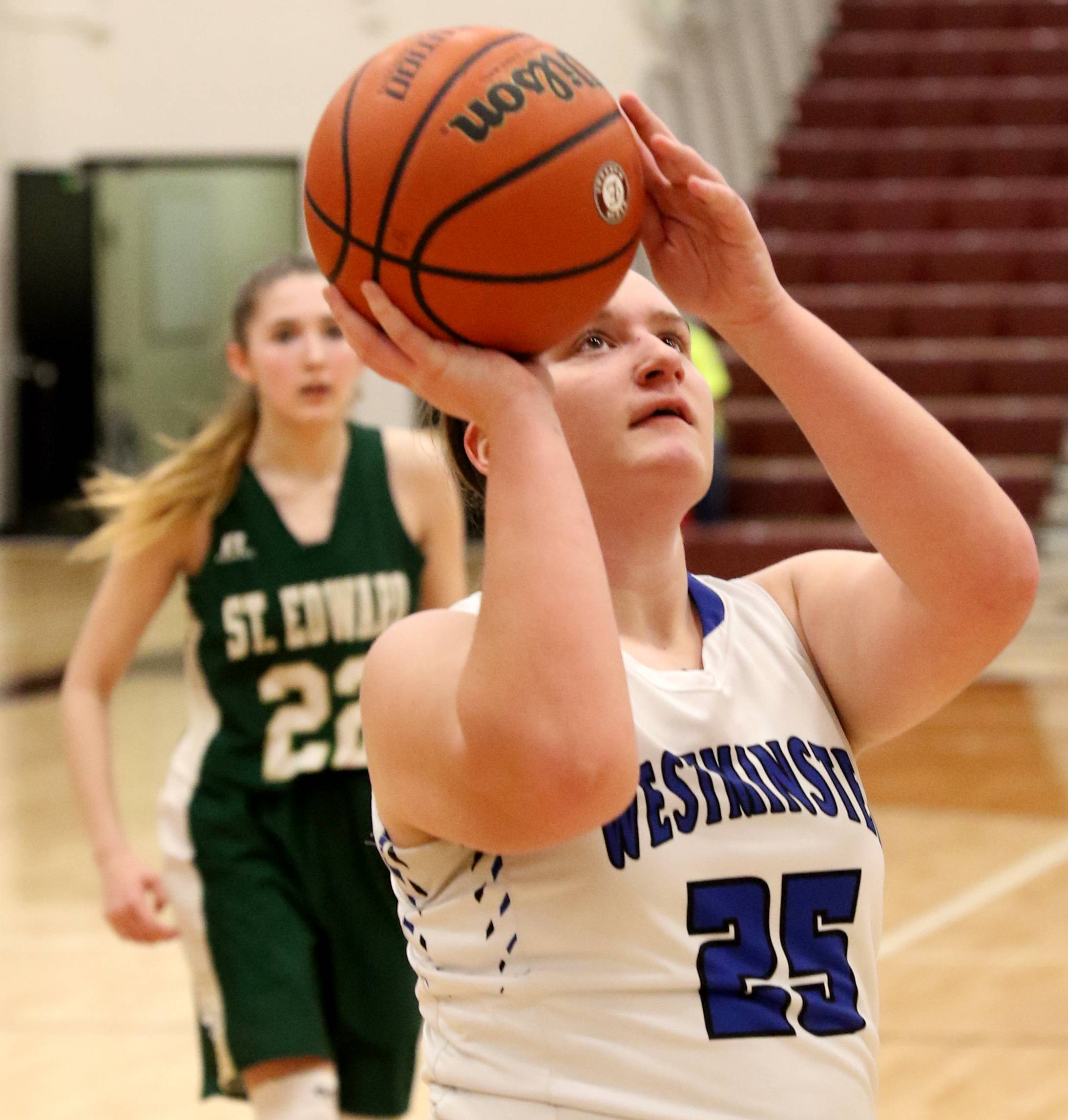 Westminster Christian's  Grace Schmitt moves to the hoop against St Edward during Elgin City Classic Girls Basketball Tournament action at Chesbrough Fieldhouse on the campus of Elgin High School Wednesday night.
