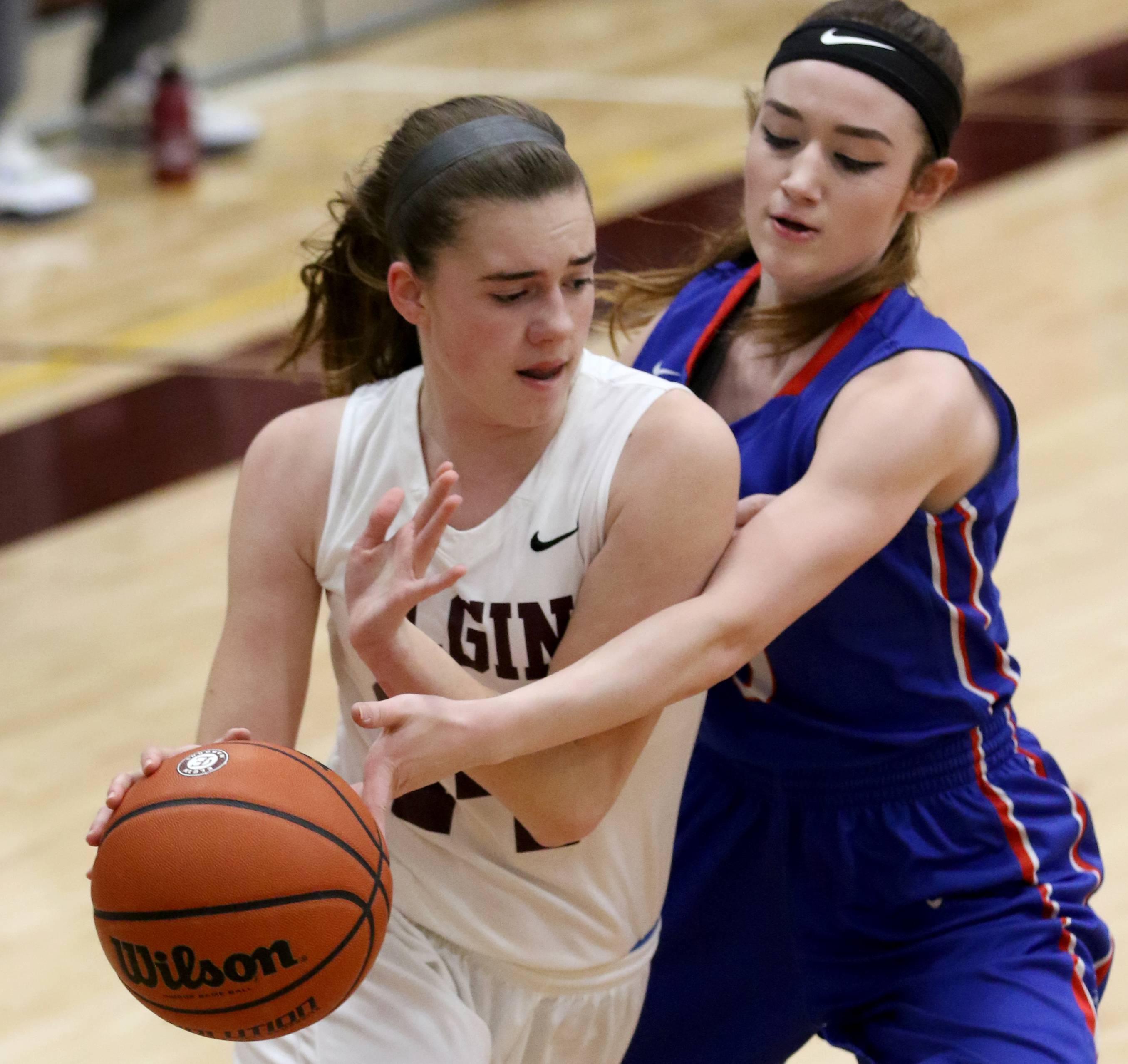 Larkin's Amber Allen, right, defends Elgin's Emily Graves during the Elgin City Classic girls basketball tournament at Chesbrough Fieldhouse on the campus of Elgin High School Wednesday night.