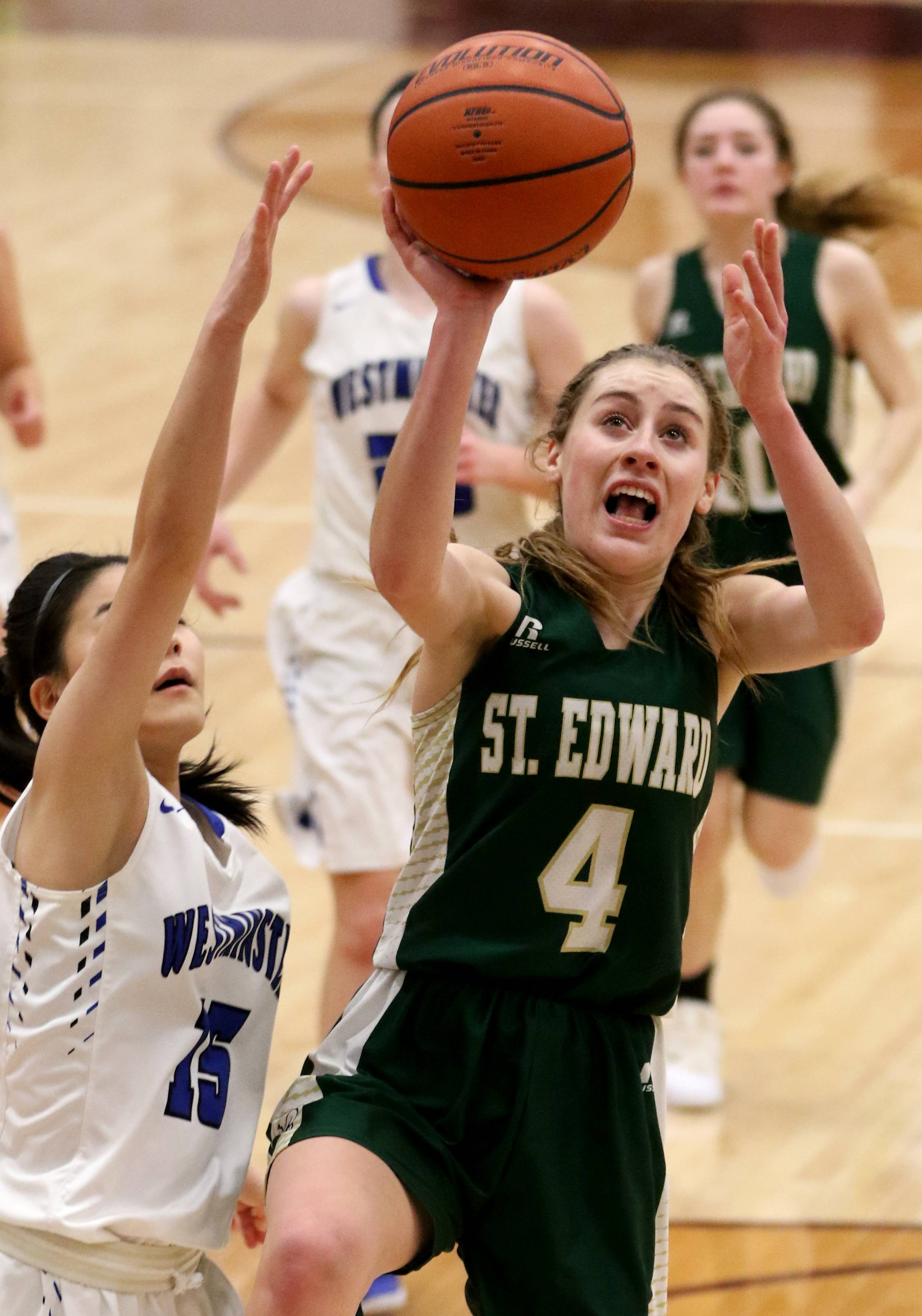 St Edward's Madeline Ellsworth moves to the hoop against Westminster Christian during Elgin City Classic Girls Basketball Tournament action at Chesbrough Fieldhouse on the campus of Elgin High School Wednesday night.