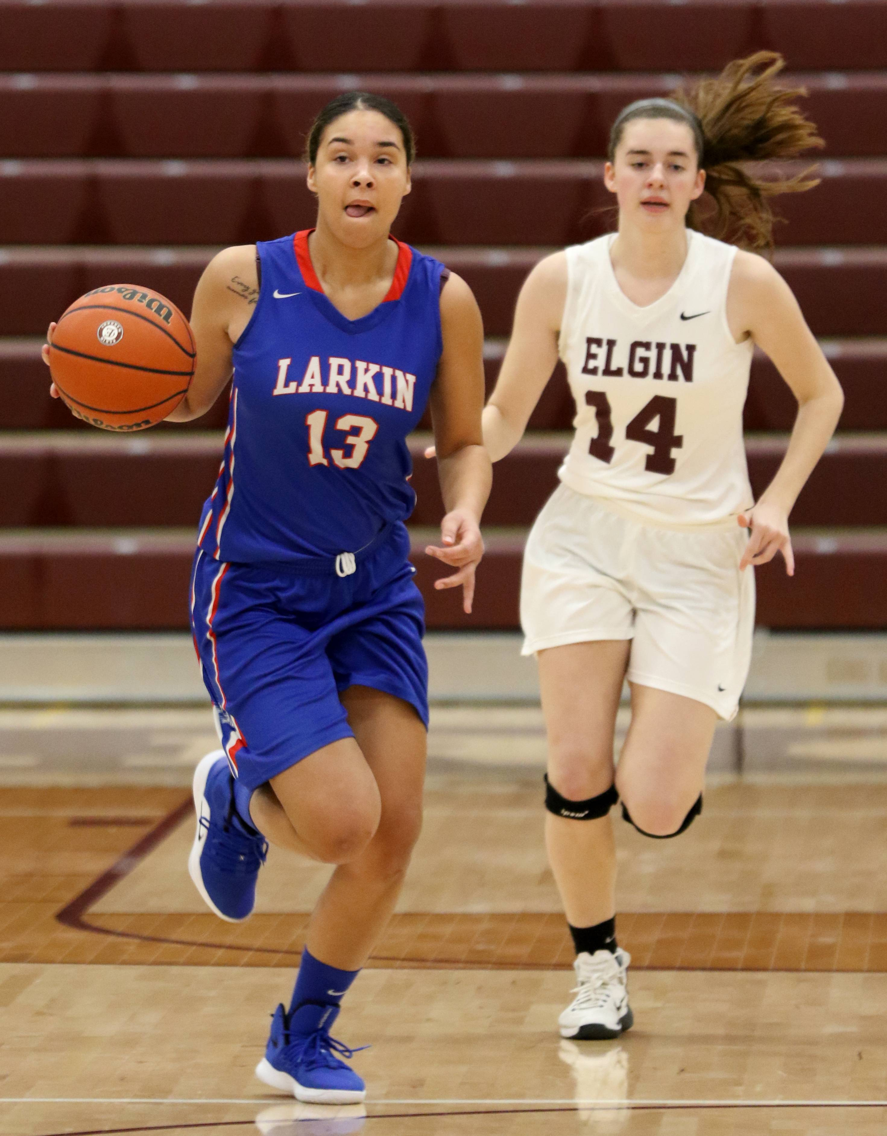 Larkin's  Brianna Young, left, brings the ball up court as Elgin's Emily Graves follows the action during Elgin City Classic Girls Basketball Tournament action at Chesbrough Fieldhouse on the campus of Elgin High School Wednesday night.