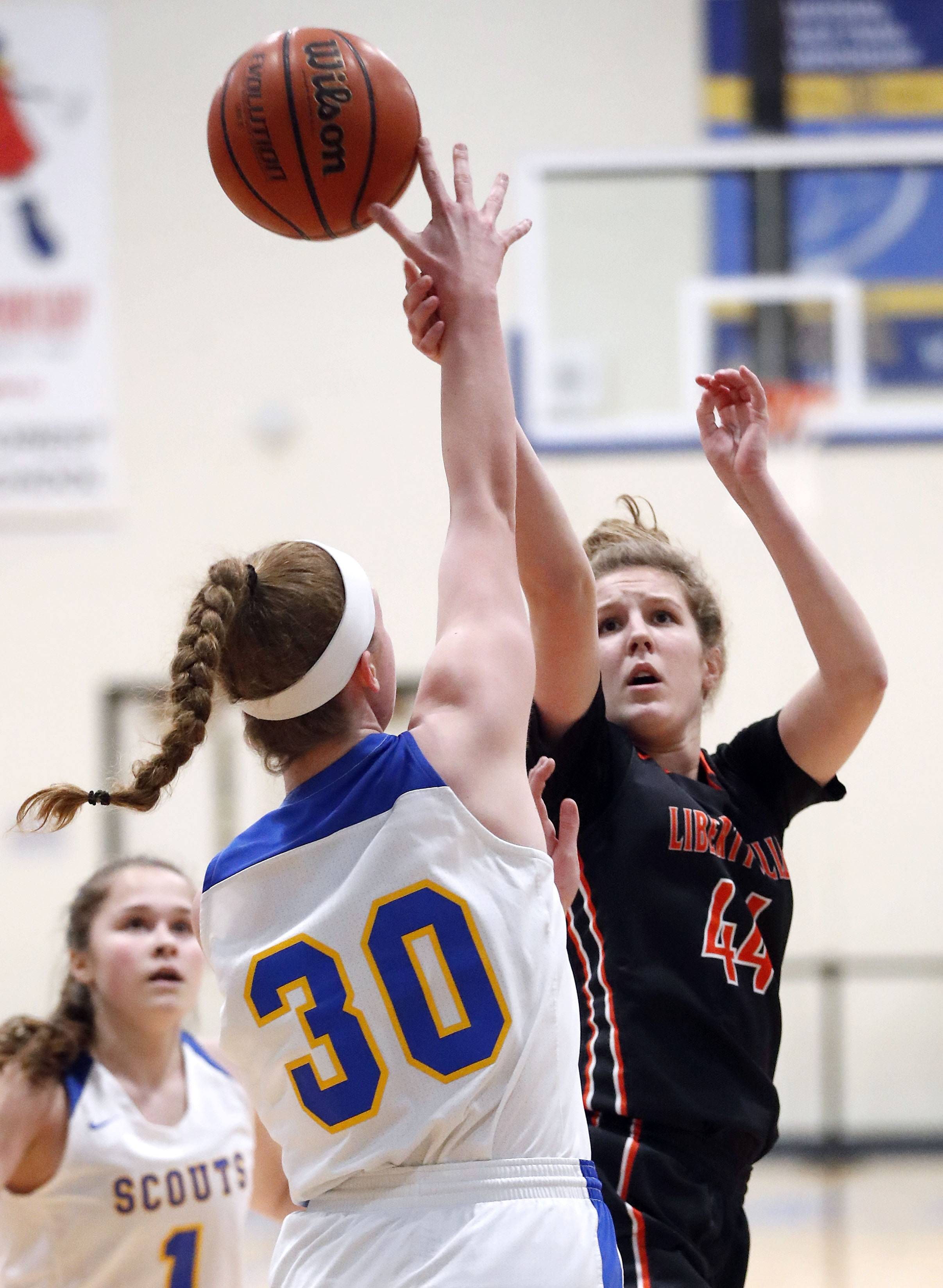 Libertyville's Lauren Huber (44) shoots over Lake Forest's Ellie Pearson during their game Wednesday night in Lake Forest.