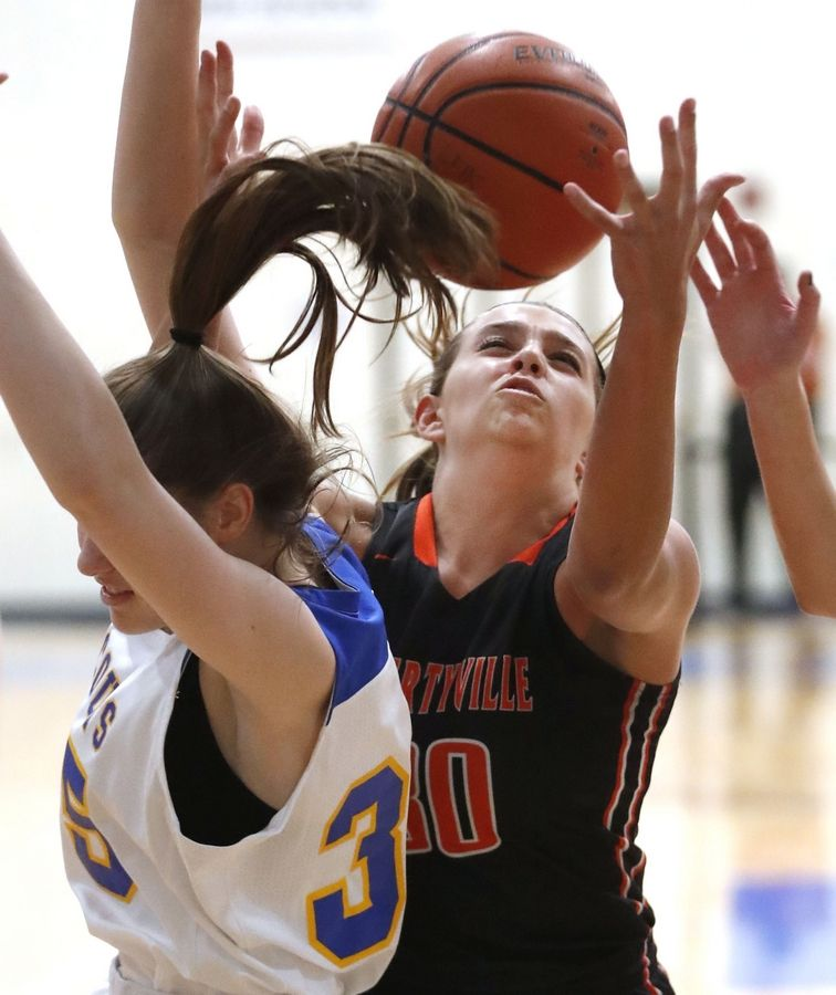 Libertyville's Maddie Spaulding right, and Lake Forest's Lilly Trkla battle for a rebound during their game Wednesday night in Lake Forest.