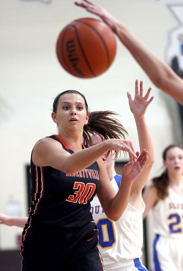 Libertyville's Maddie Spaulding passes during their game Wednesday night in Lake Forest.