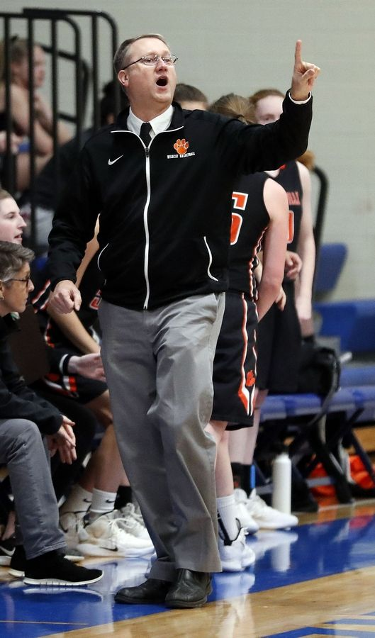 Libertyville head coach Greg Pedersen calls out a play during their game Wednesday night in Lake Forest.