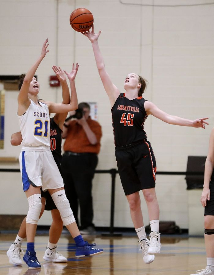 Lake Forest's Halle Douglass, left, and Libertyville's Abigail Frea battle for a rebound during their game Wednesday night in Lake Forest.
