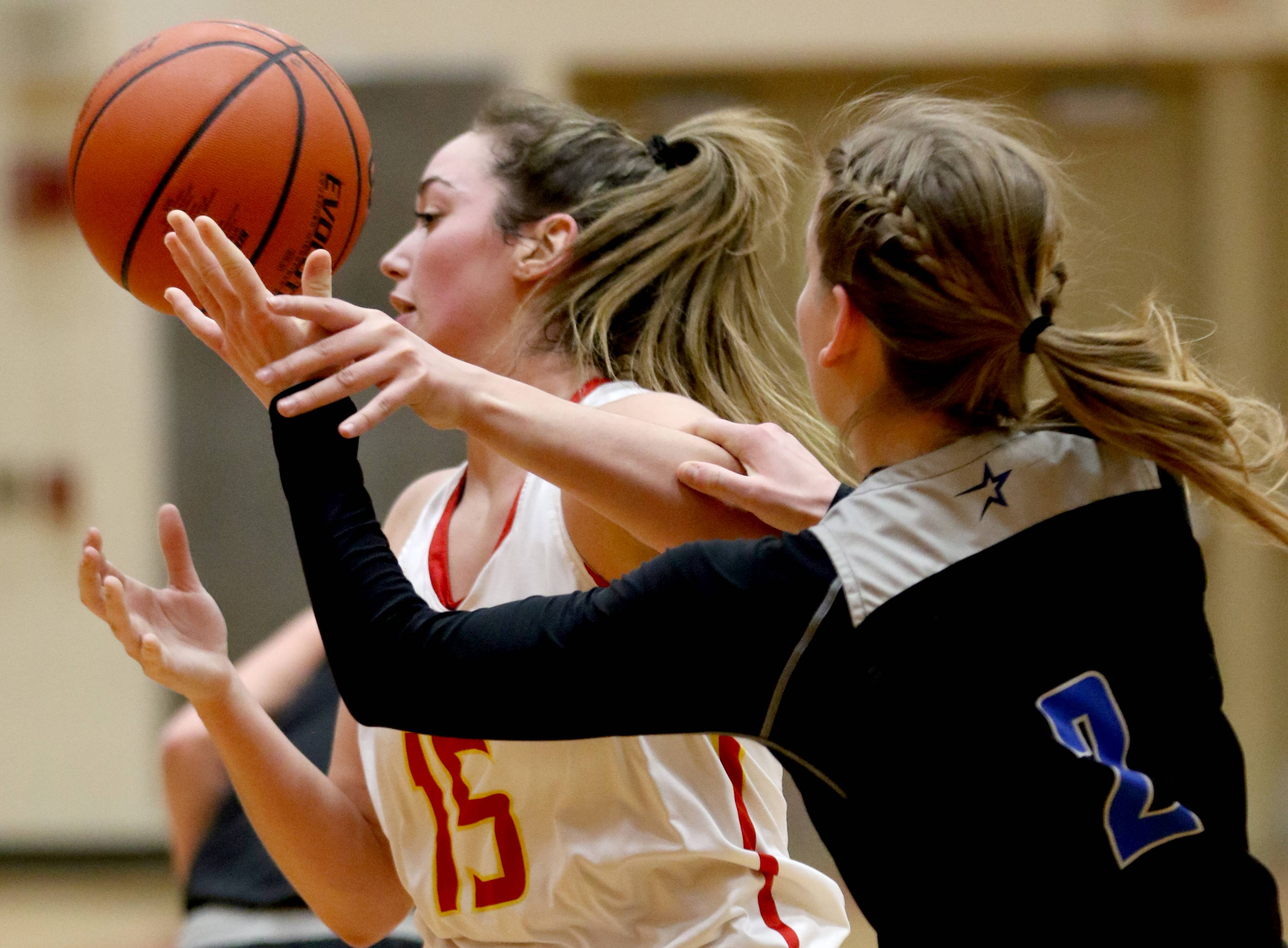 Batavia's Ava Sergio, left, loses control of the ball under pressure from St. Charles North's Emma Ludwig during varsity girls basketball at Batavia Thursday night.
