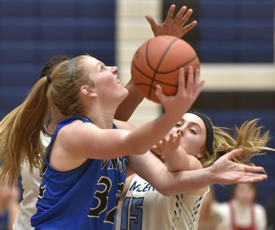 Geneva's Lindsay Blackmore shoots against Lake Park's Darrione Rogers and Carolyn Vehrs Thursday in a girls basketball game in Roselle.