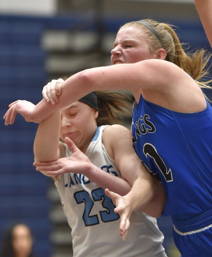 Geneva's Lindsay Blackmore is fouled by Lake Park's Casey Darre Thursday in a girls basketball game in Roselle.