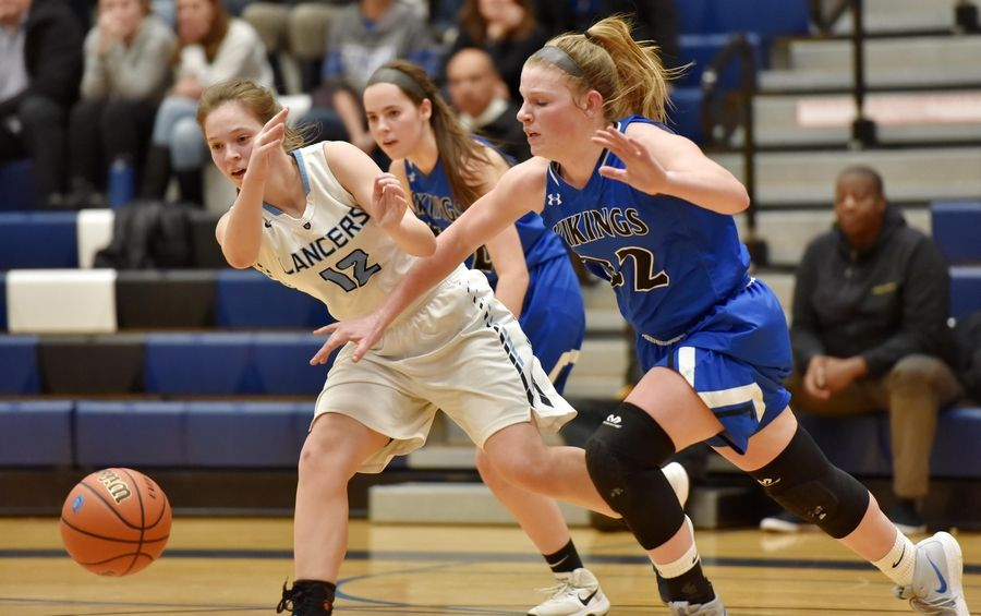 Geneva's Lindsay Blackmore disrupts a pass by Lake Park's Katherine Kirkham Thursday in a girls basketball game in Roselle.