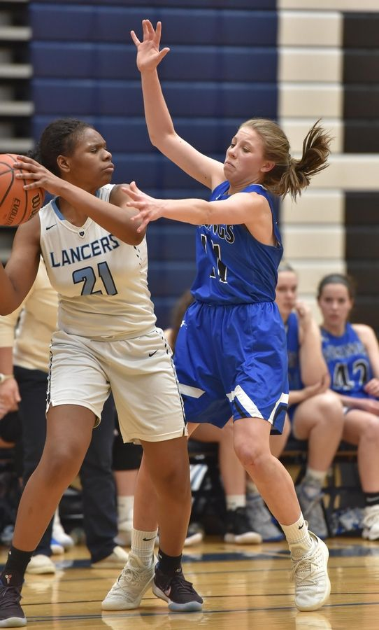 Geneva's Grace Hinchman defends Lake Park's Darrione Rogers Thursday in a girls basketball game in Roselle.