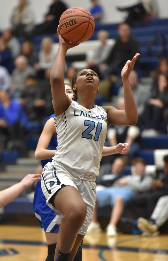 Lake Park's Darrione Rogers glides in for a layup against Geneva Thursday in a girls basketball game in Roselle.