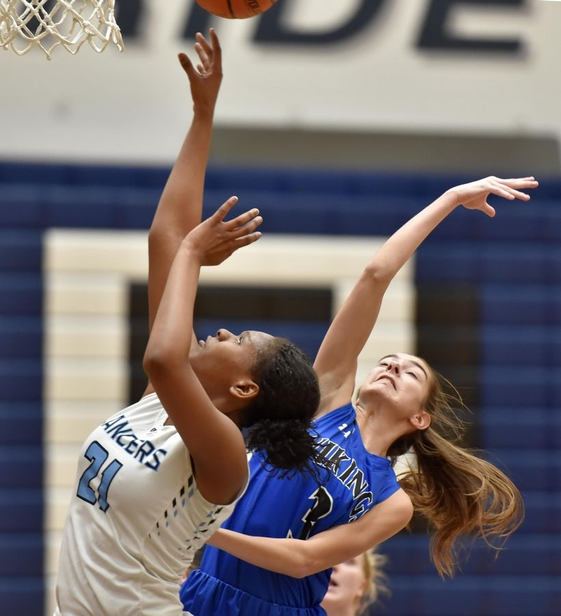 Lake Park's Darrione Rogers and Geneva's Katherine Palmer compete for a rebound Thursday in a girls basketball game in Roselle.