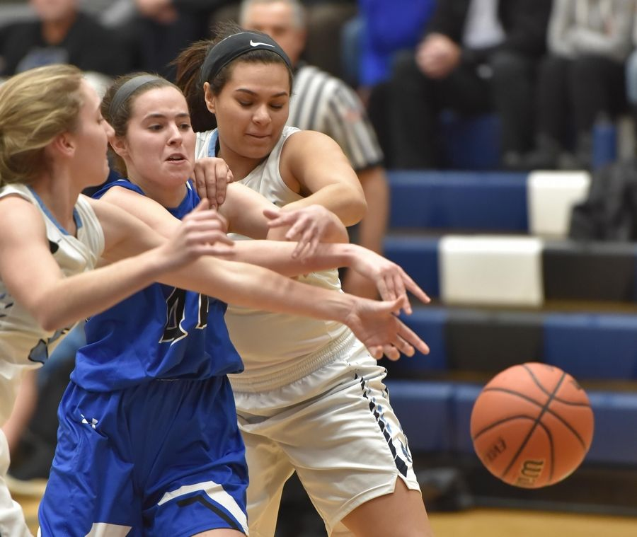 Geneva's Cassidy Navigato and Lake Park's Emma Thorne and Brayana Walker, right, chase the ball Thursday in a girls basketball game in Roselle.
