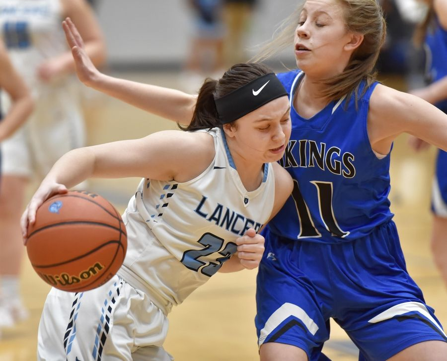 Lake Park's Casey Darre drives into Geneva's Grace Hinchman Thursday in a girls basketball game in Roselle.