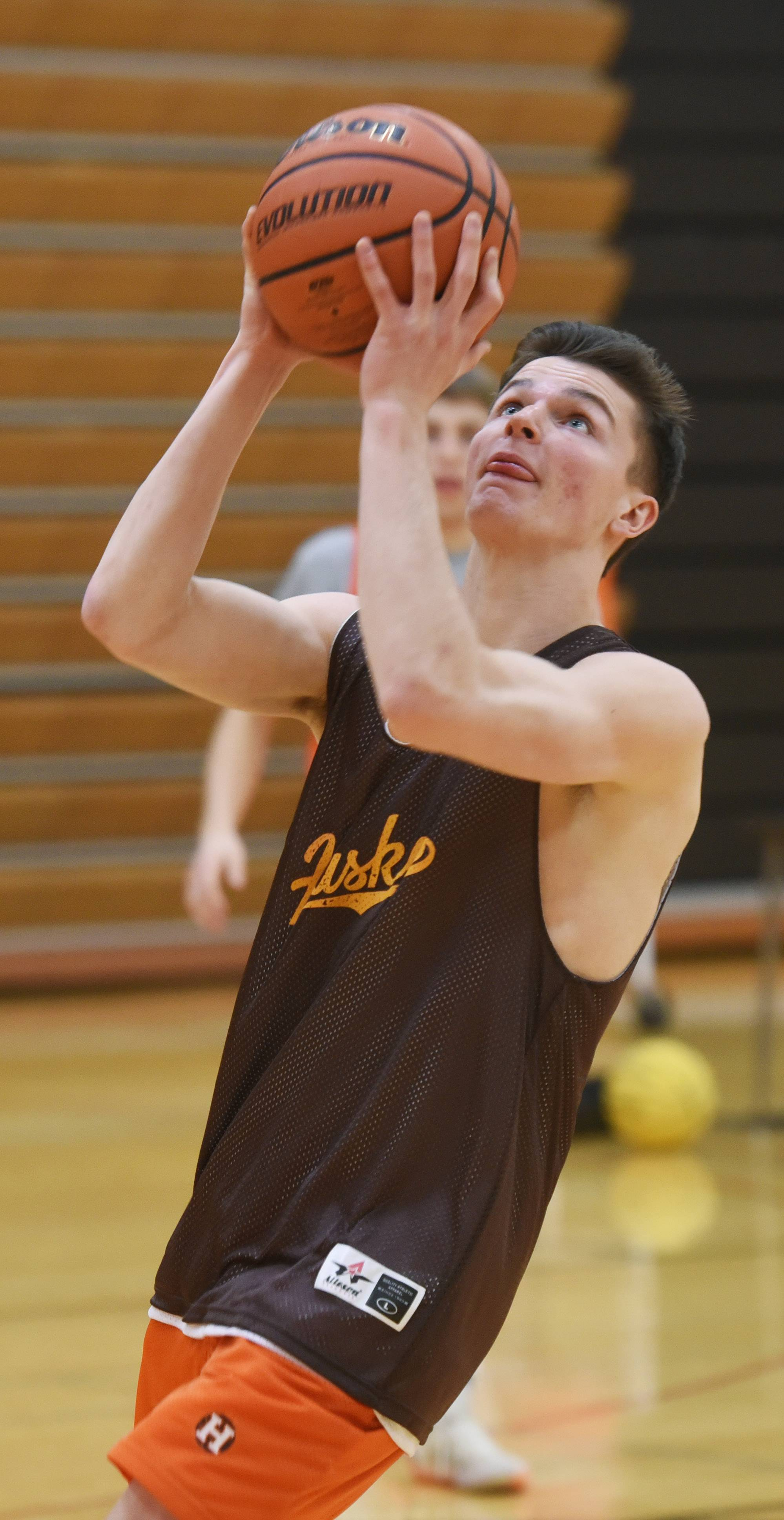 Hersey basketball player Jason Schmidt participates in a drill during practice. He was the lead in the school's Fall musical, and has been in many other theater productions as well.