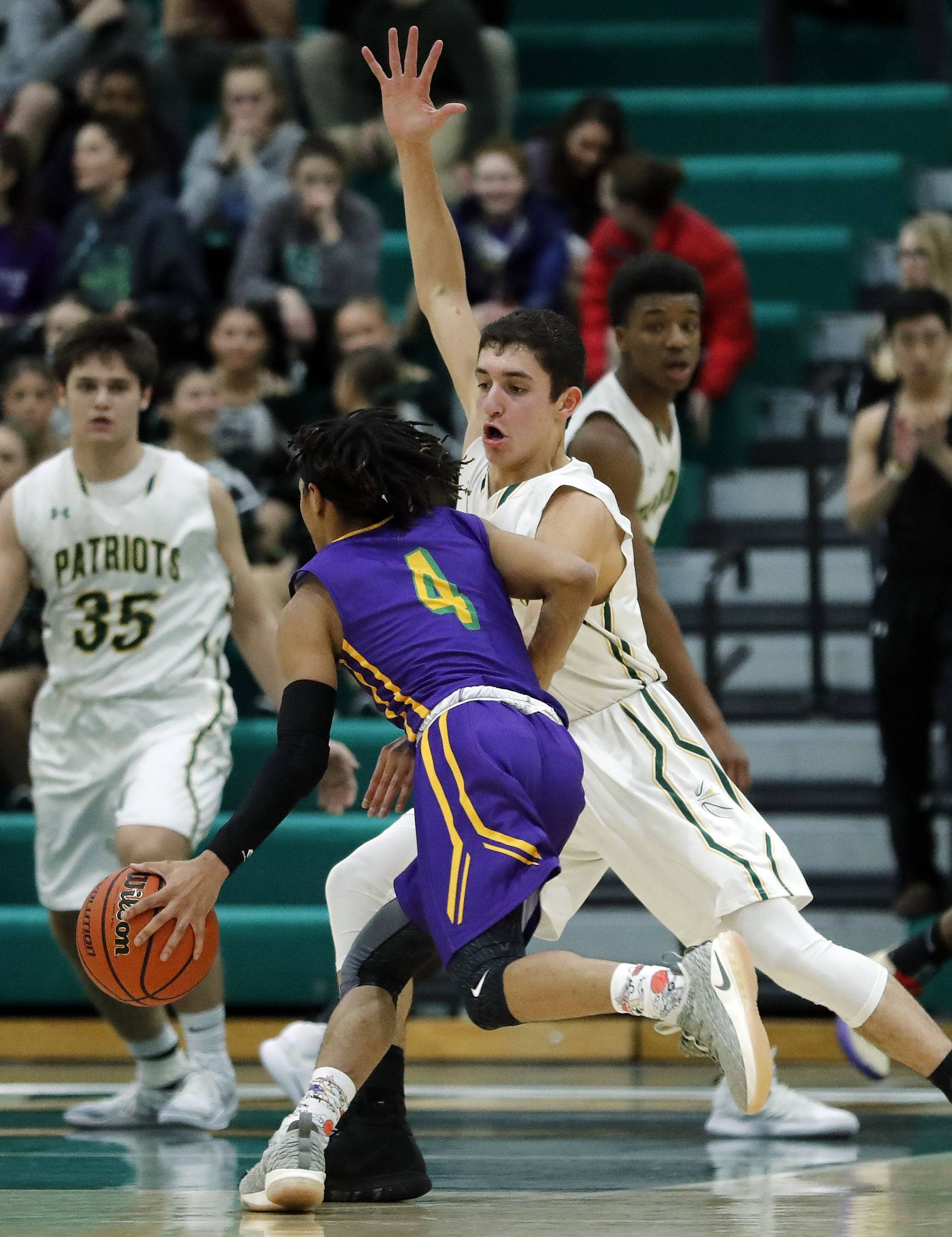 Stevenson's John Ittounas, right, defends against Waukegan's Andre White during their game Friday night in Lincolnshire.