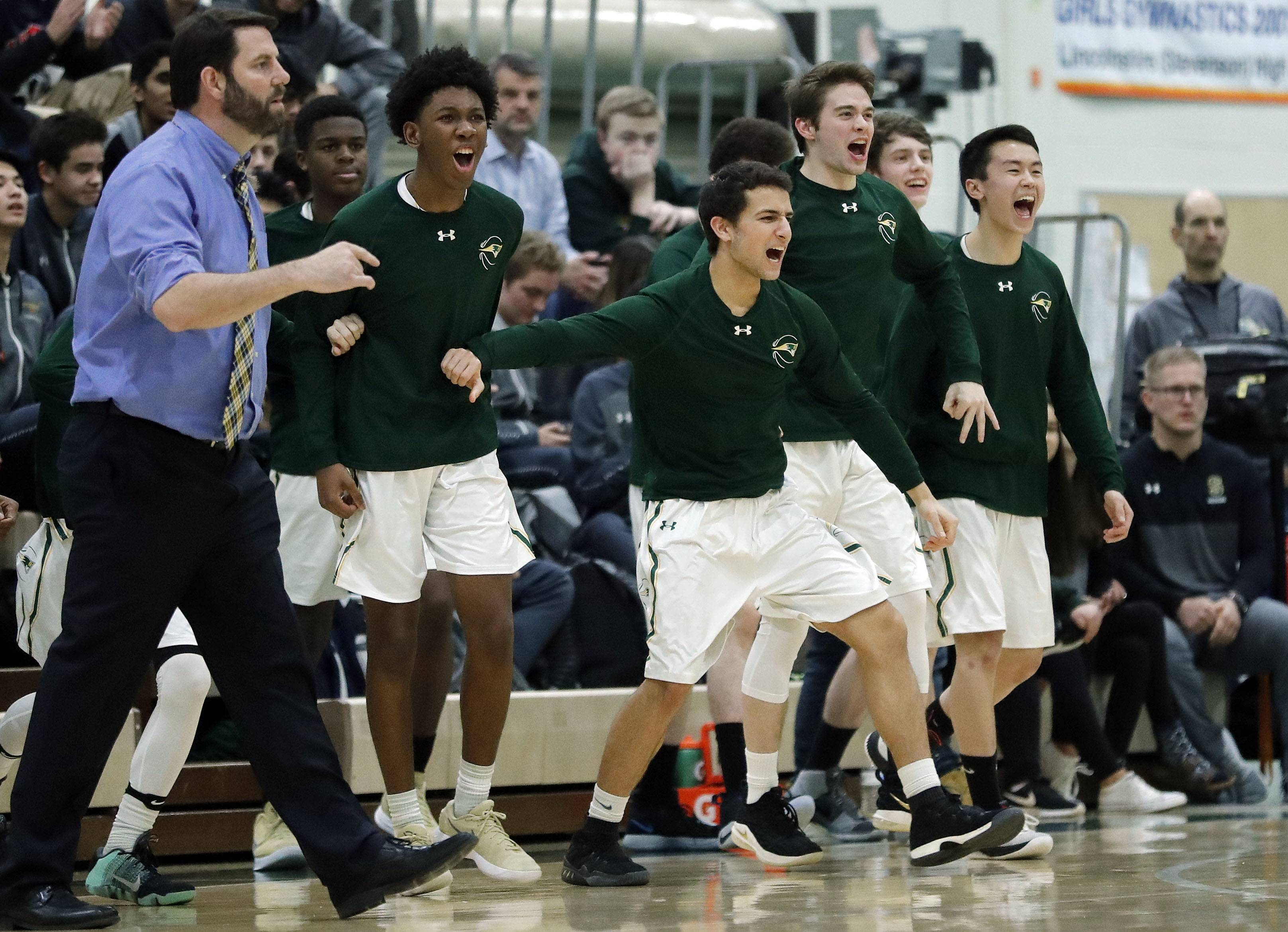 Stevenson's bench cheers during their game against Waukegan Friday night in Lincolnshire.