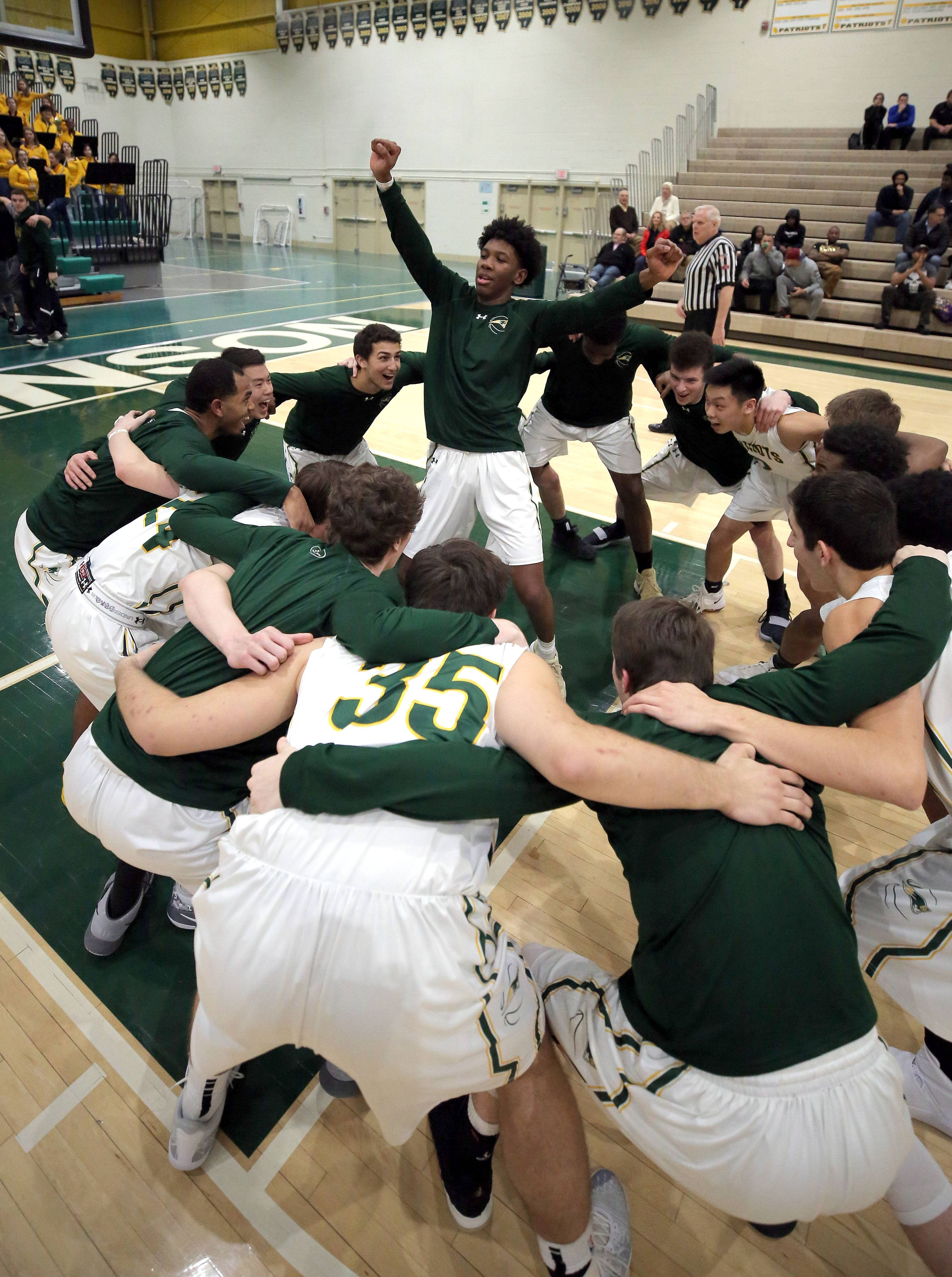Stevenson players celebrate before their game against Waukegan Friday night in Lincolnshire.