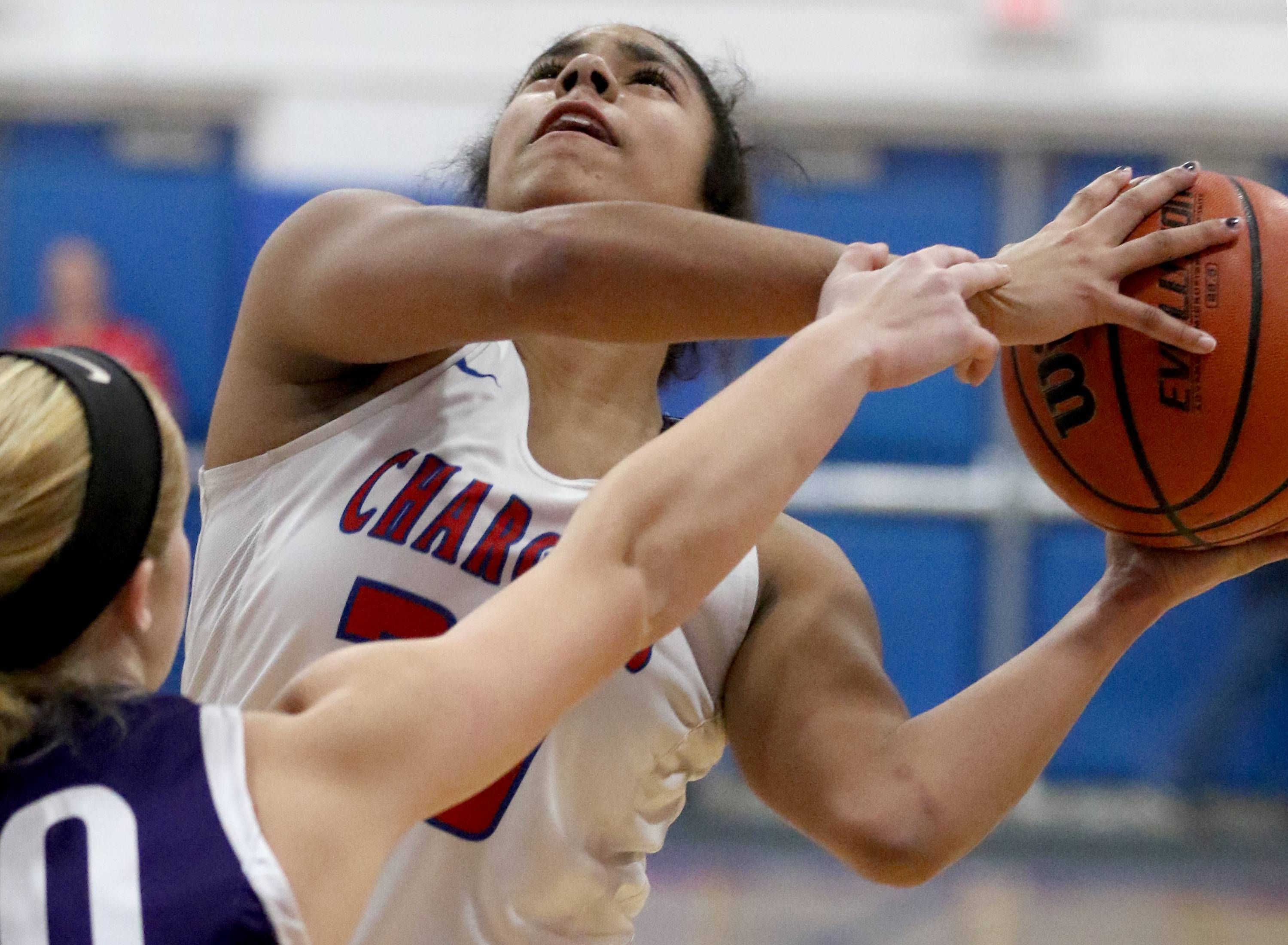 Patrick Kunzer/pkunzer@dailyherald.comDundee-Crown's Alyssa Crenshaw fights for a shot at the hoop against Hampshire during varsity girls basketball at Carpentersville Friday night.